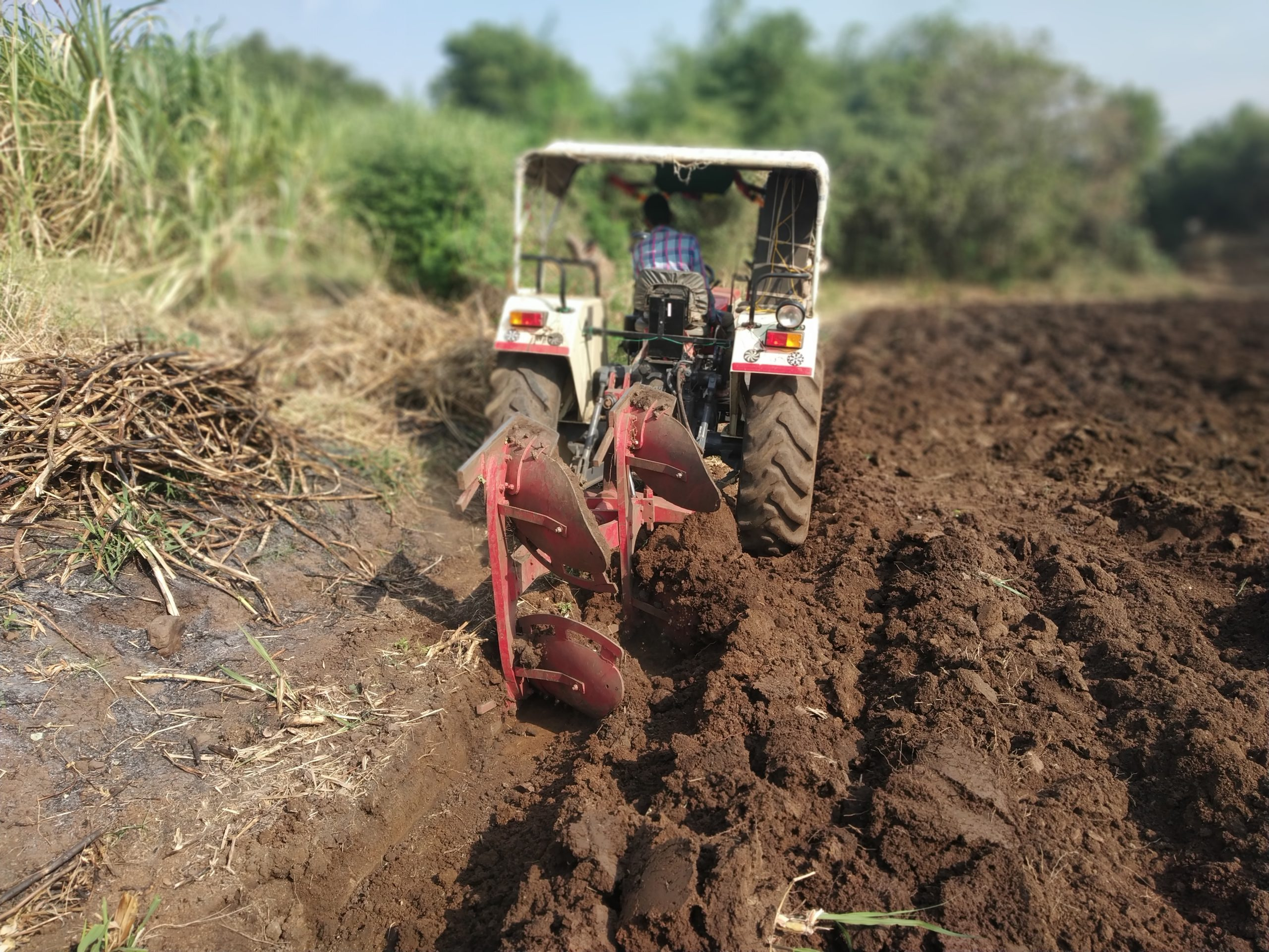 A tractor ploughing the fields