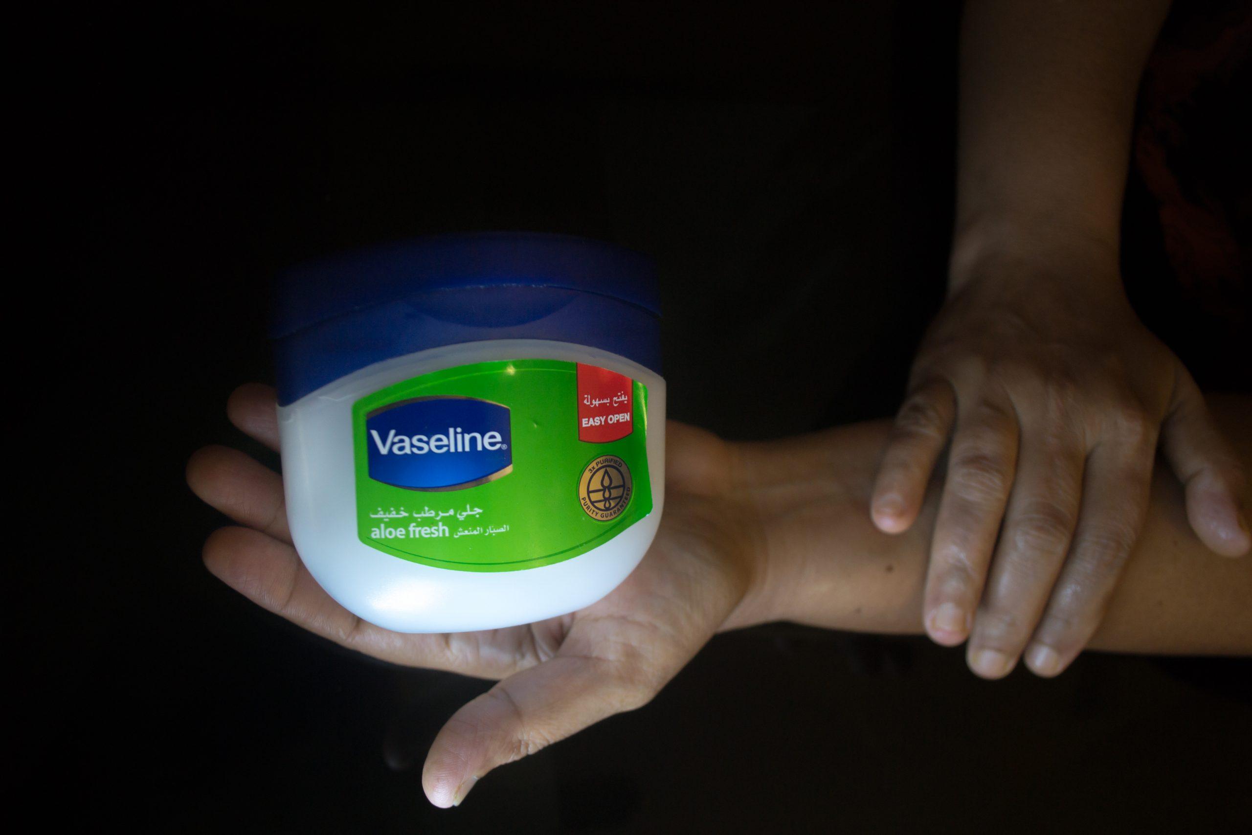 A vaseline moisturizer in hand