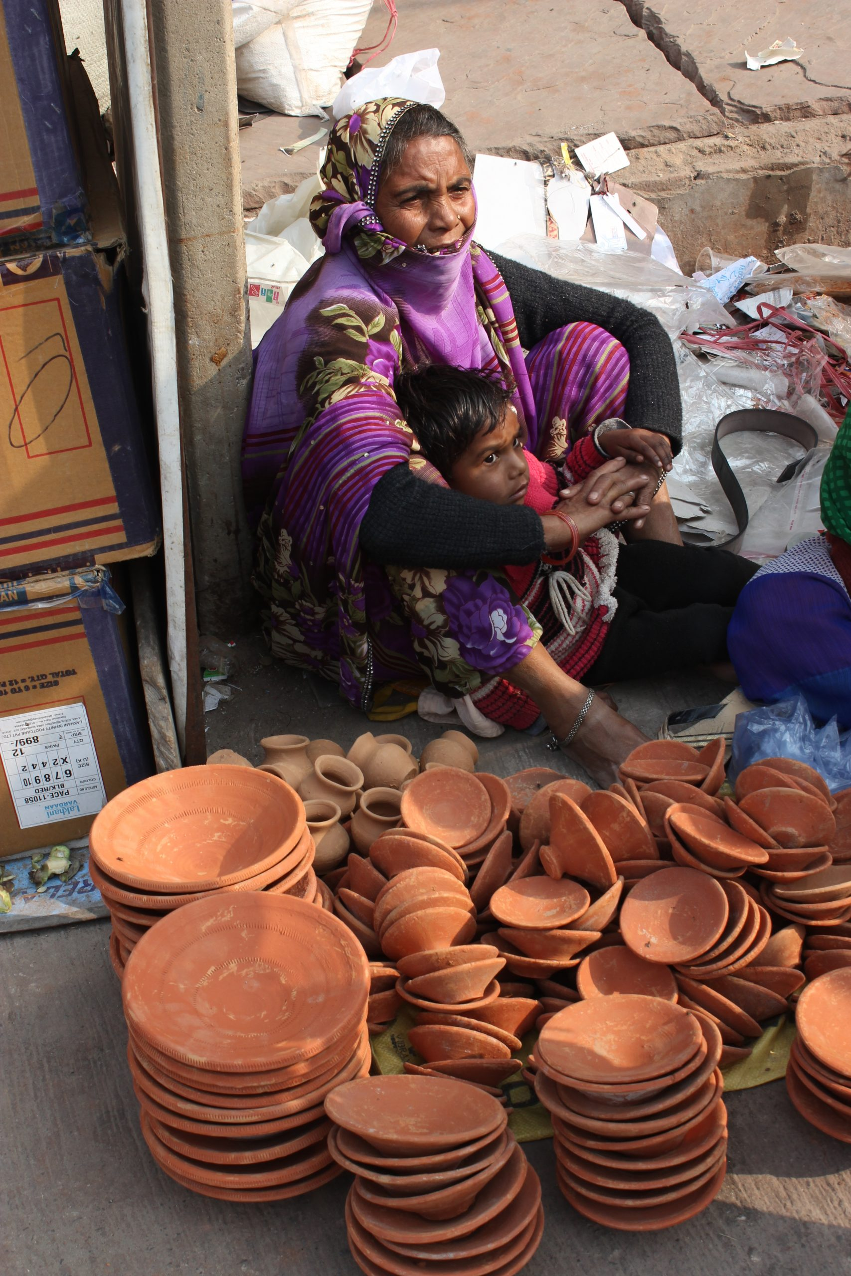 A woman selling clay pots