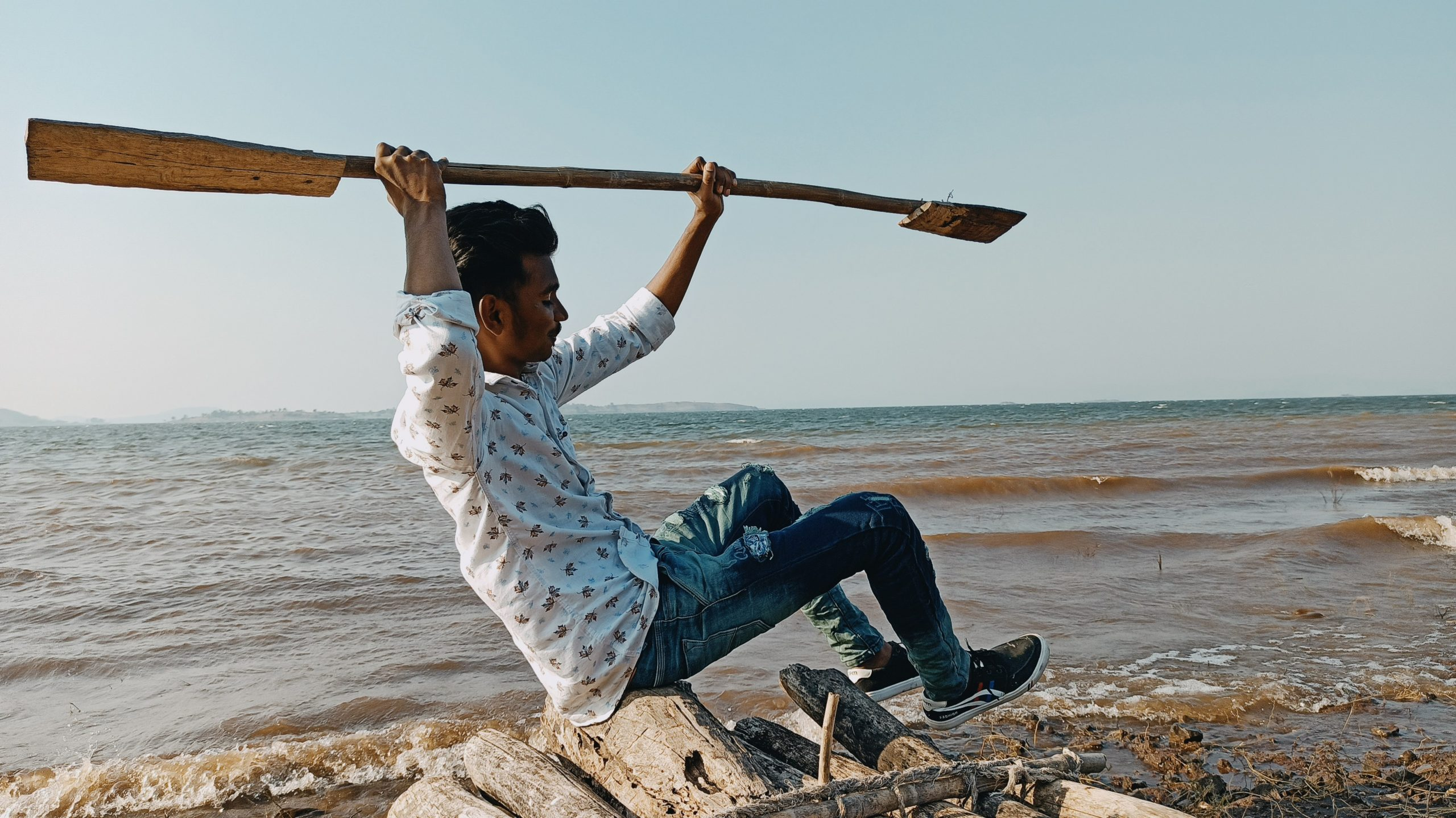 A boy on a wooden boat