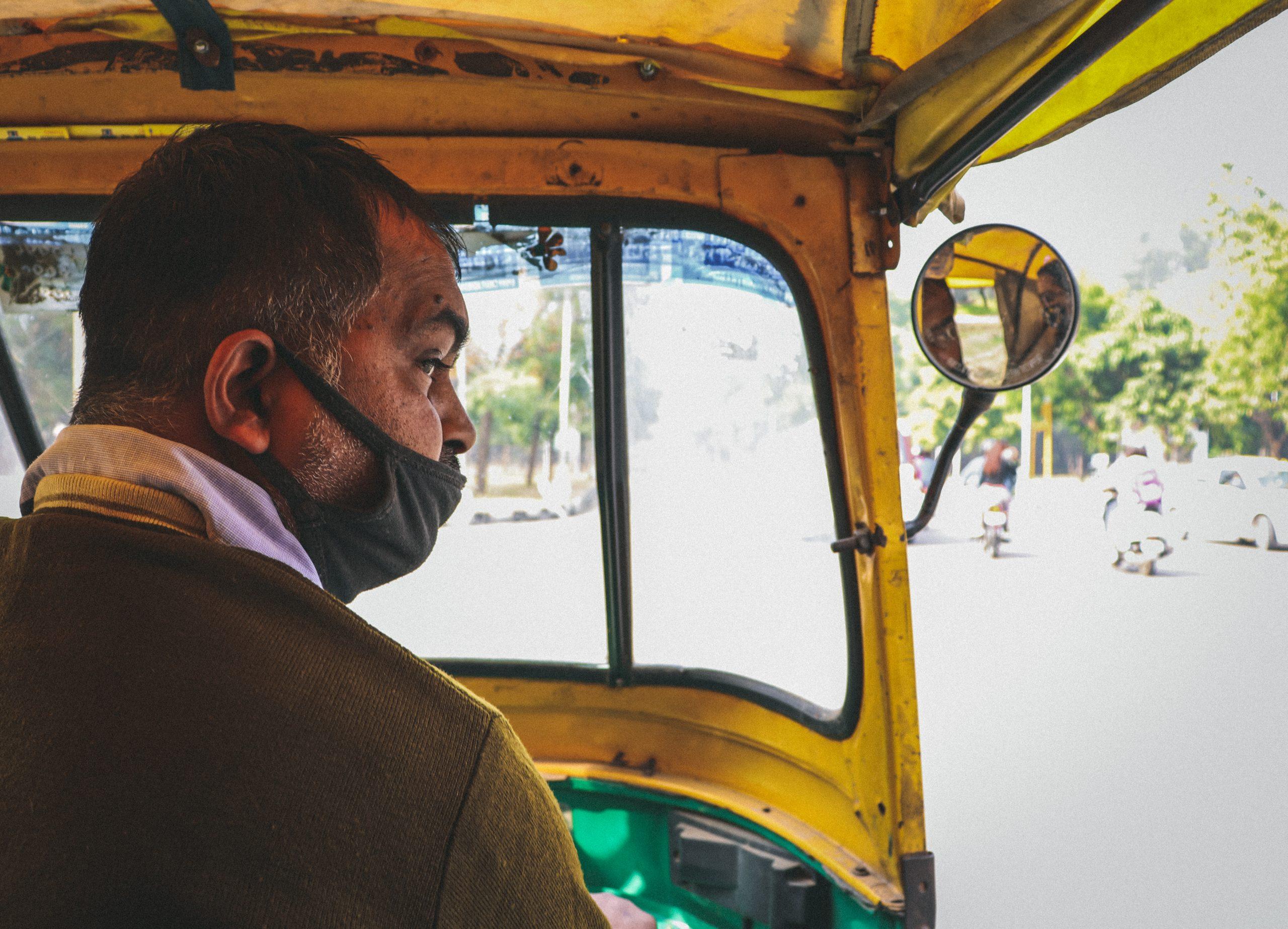 An auto rickshaw driver