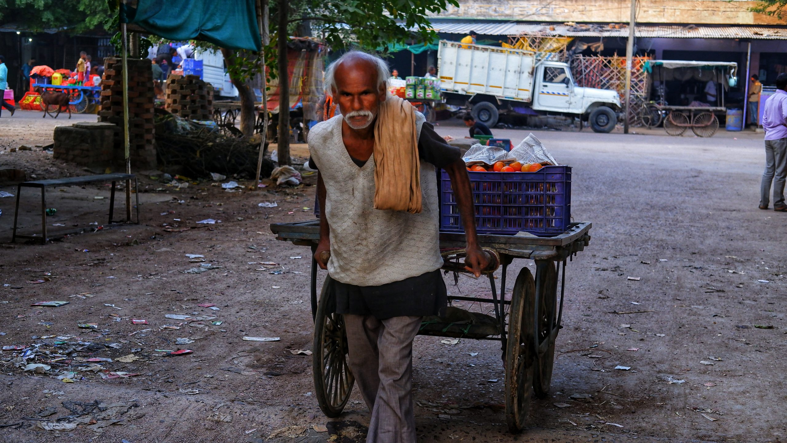 An old man pulling a cart