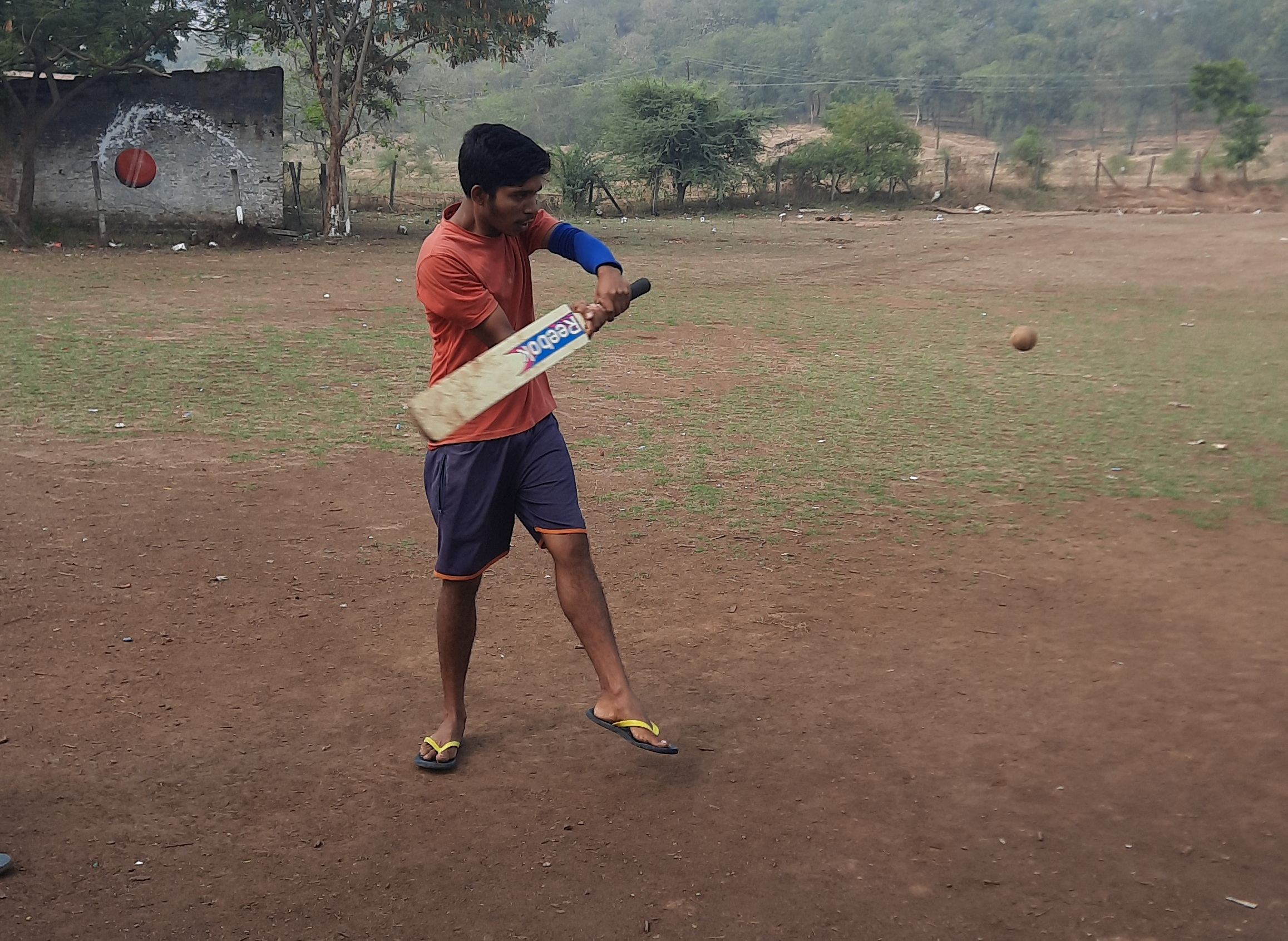 Batsman about to hit a ball with bat