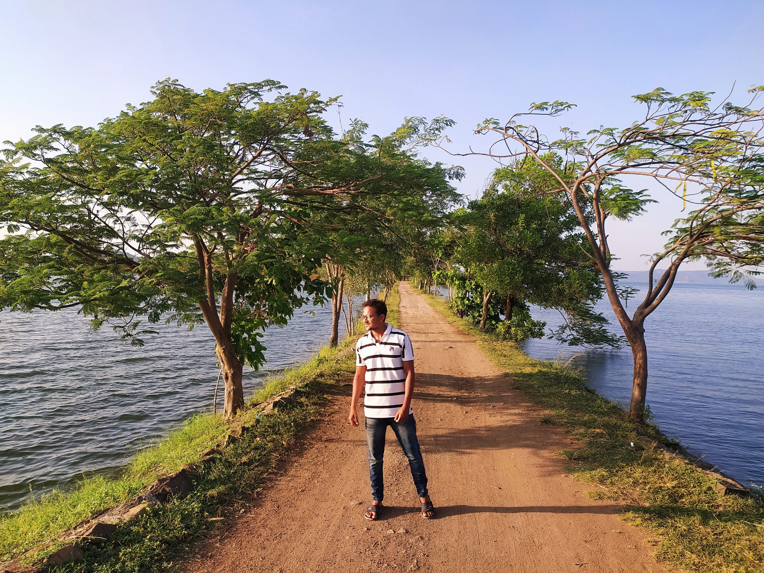 Man standing on the road in a sea