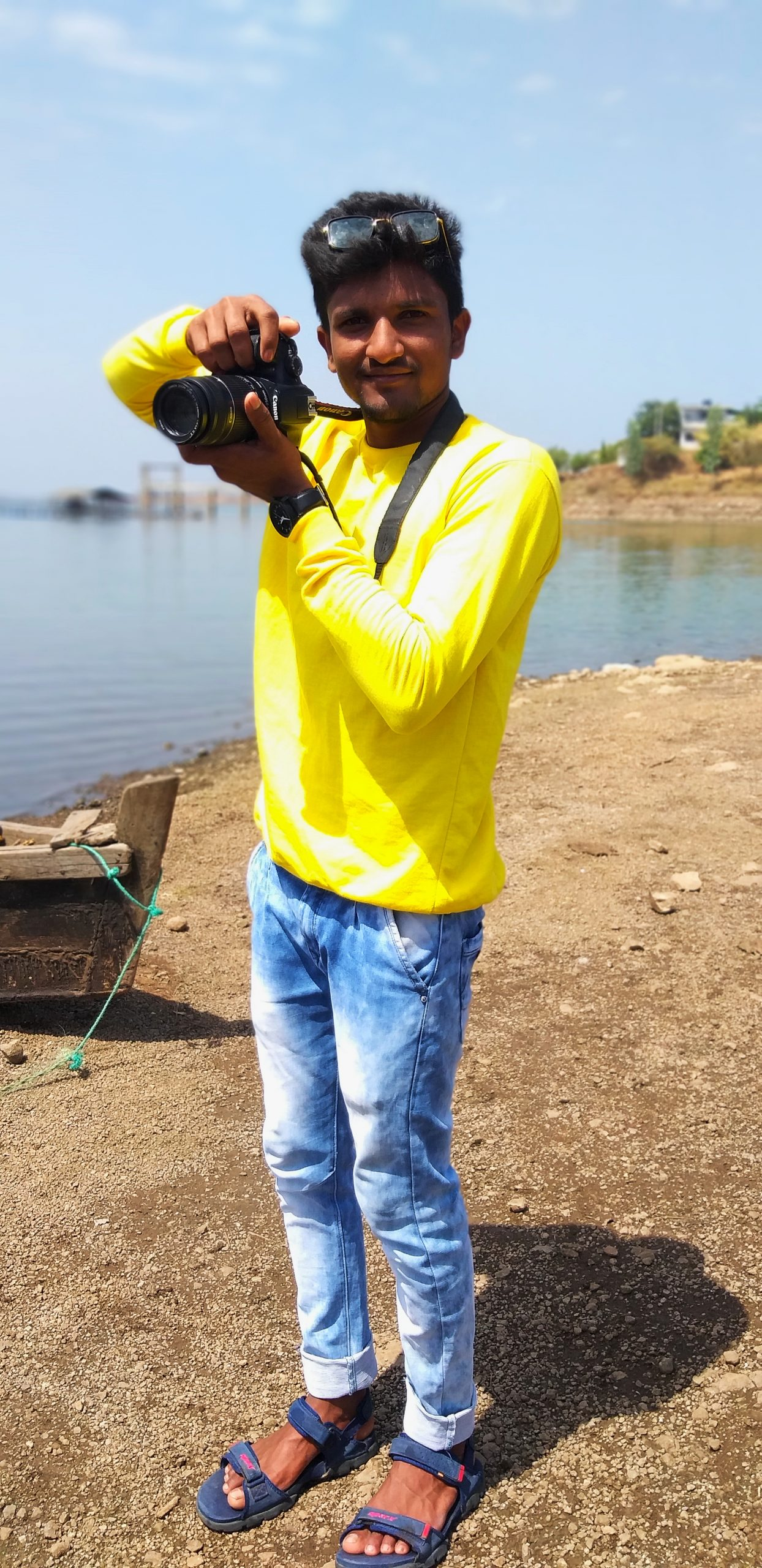 Boy posing with camera