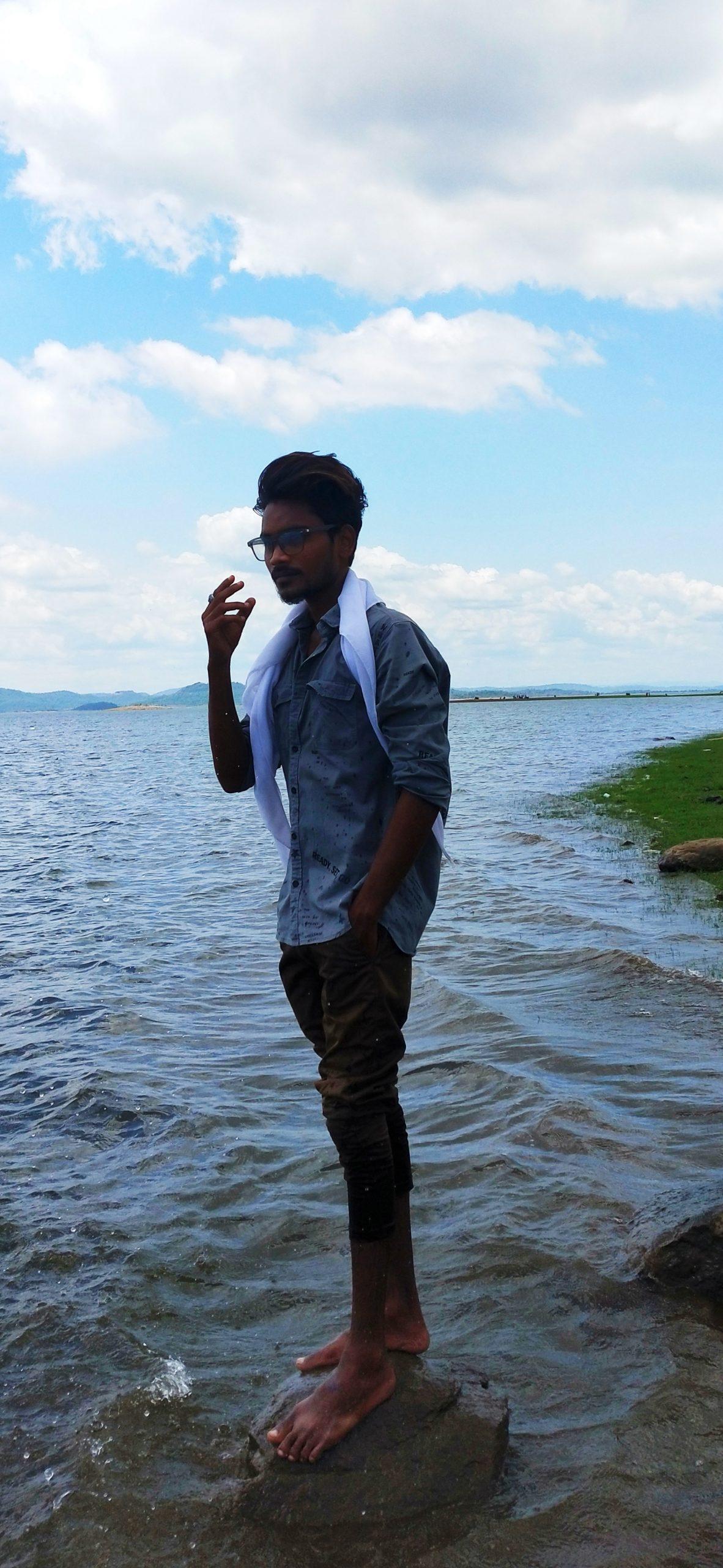 Boy posing in water