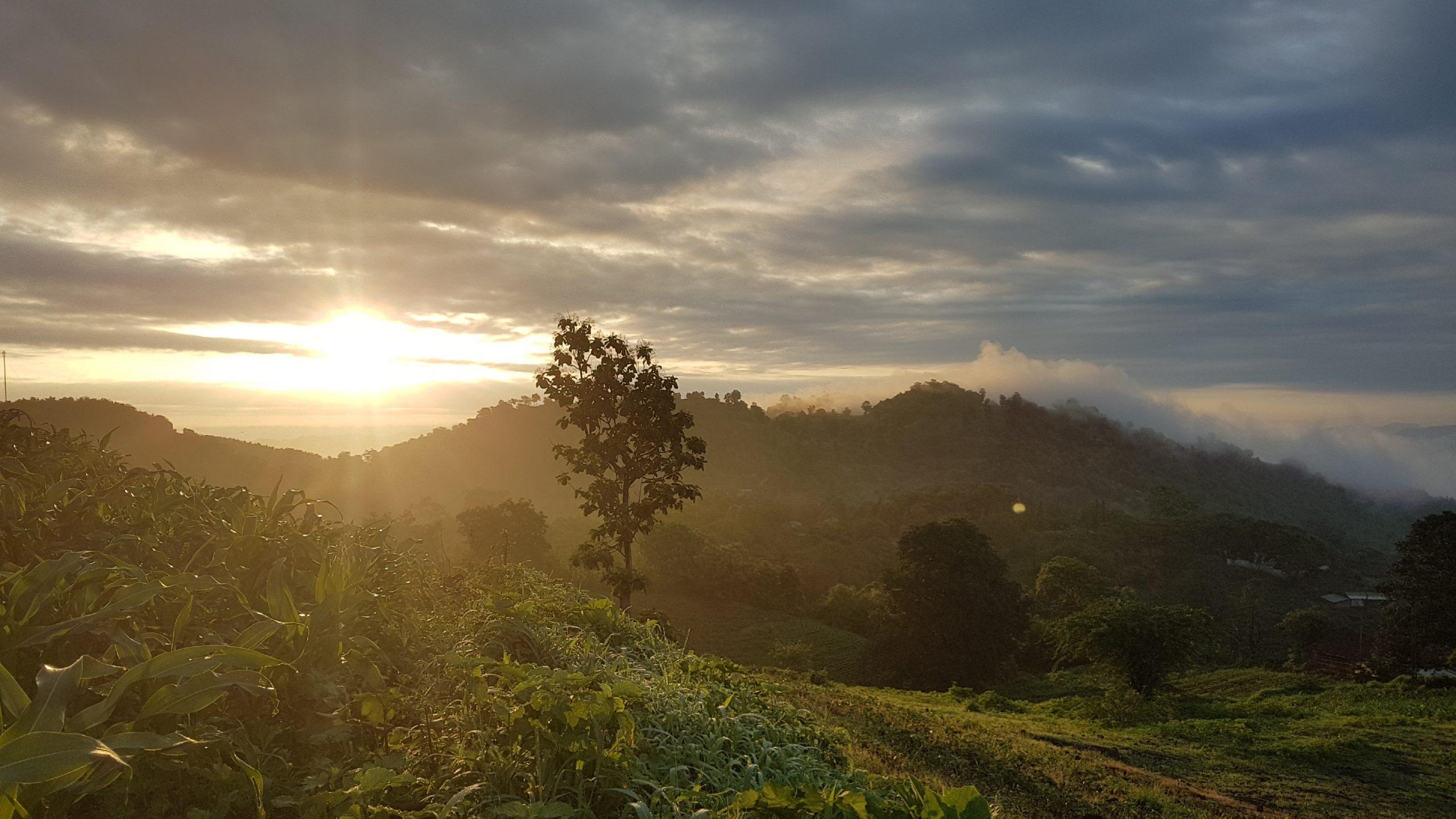 setting sun among mountains