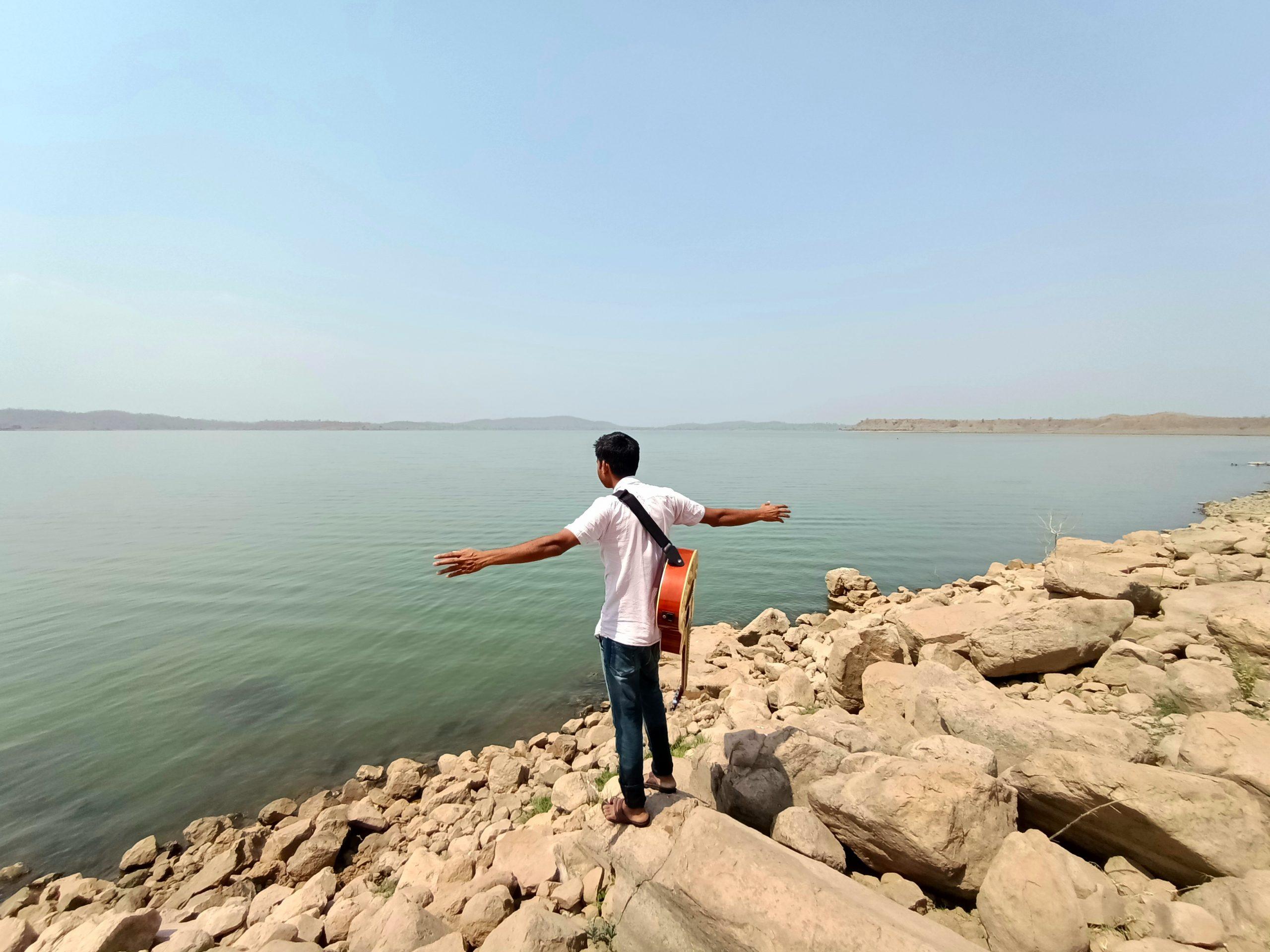 A boy at a river bank
