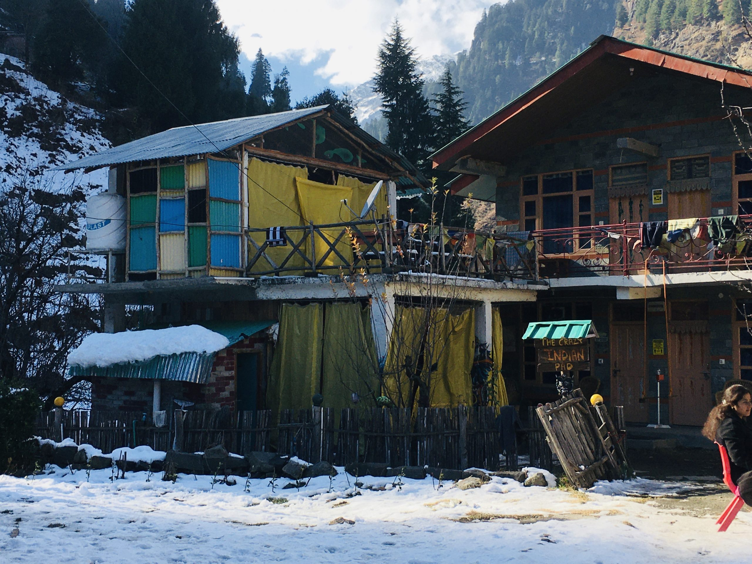 Wooden houses under snowy mountains