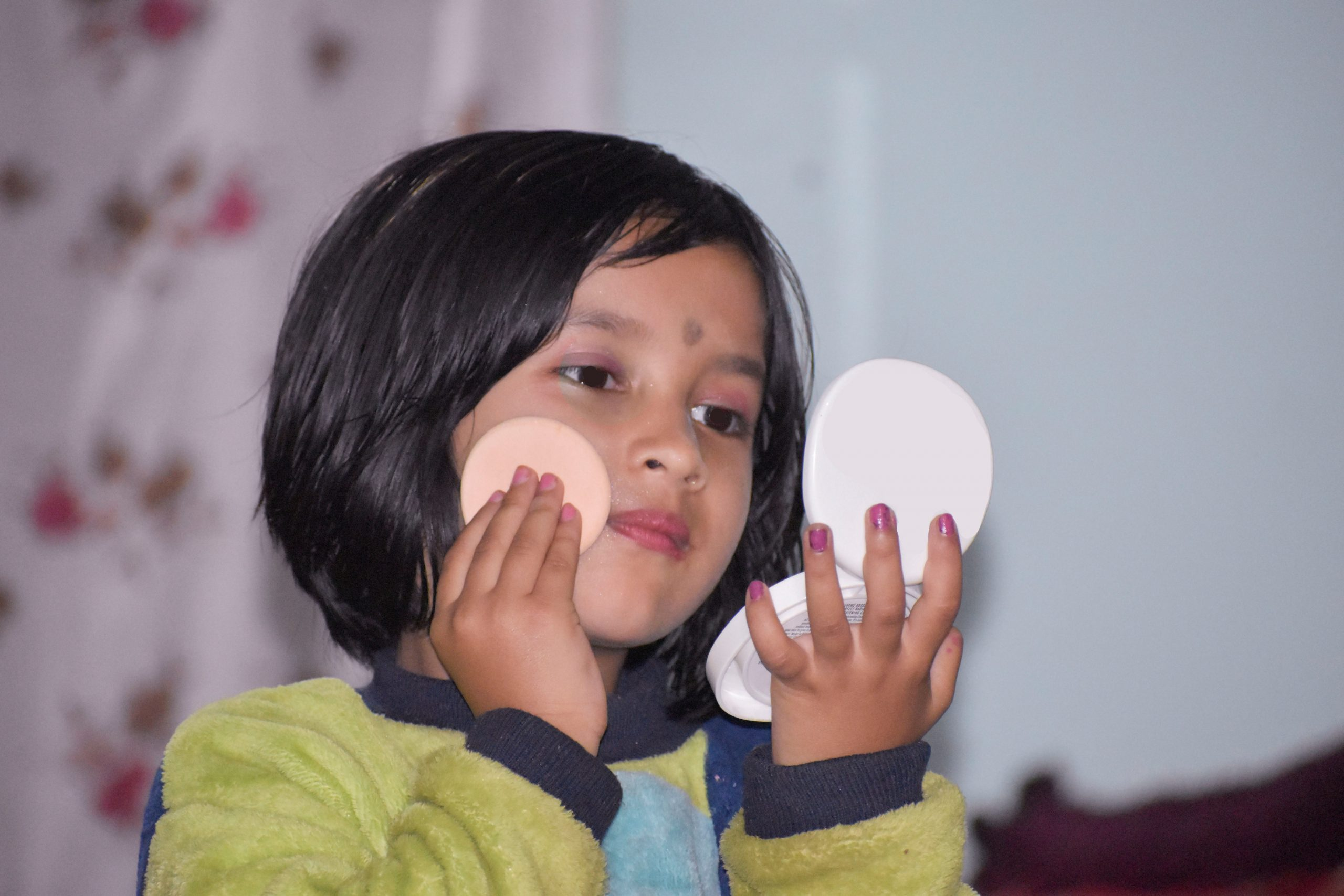 Little girl doing makeup