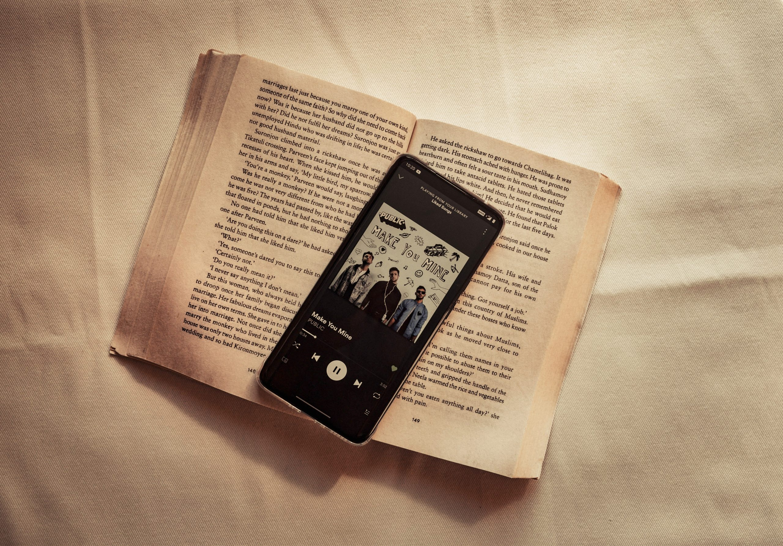 book and music on mobile phone