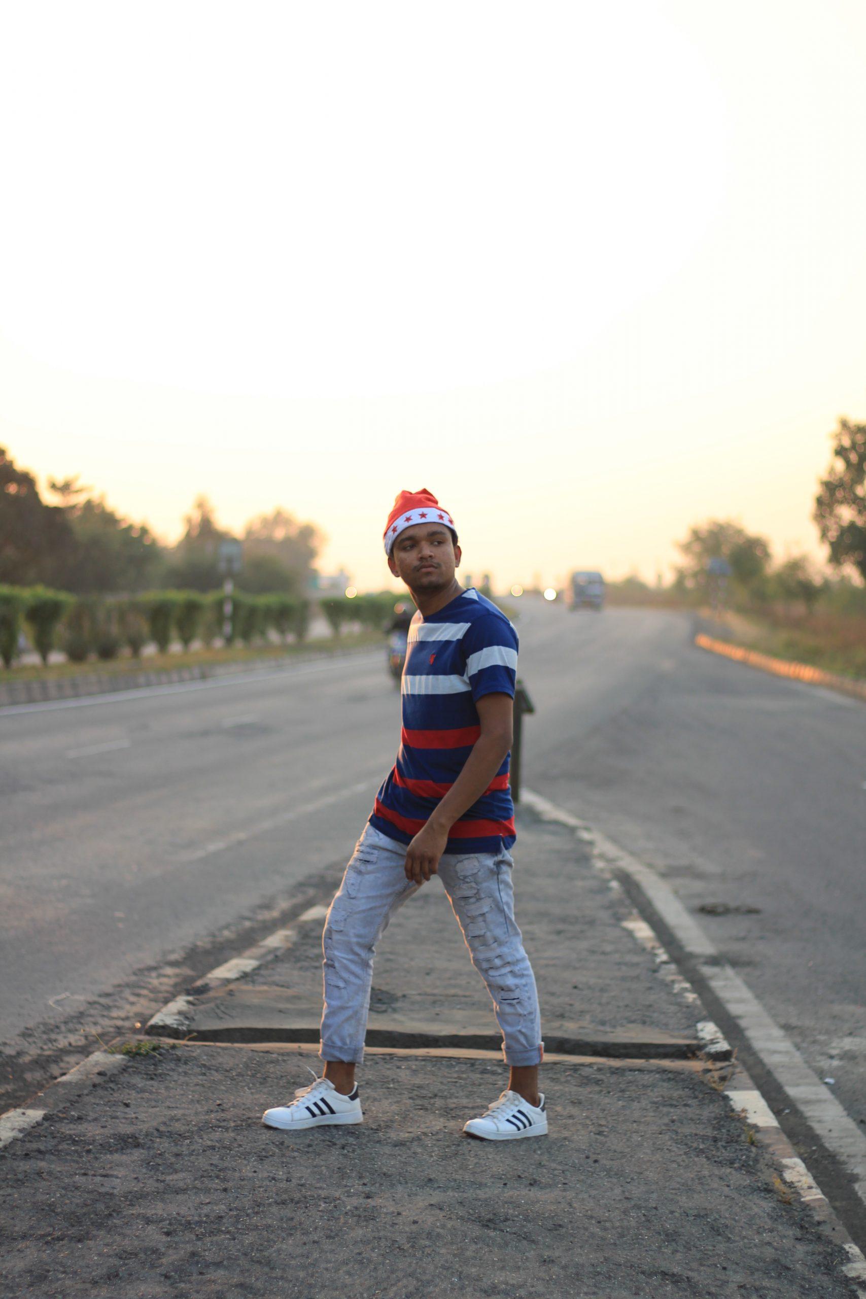 Boy posing on highway