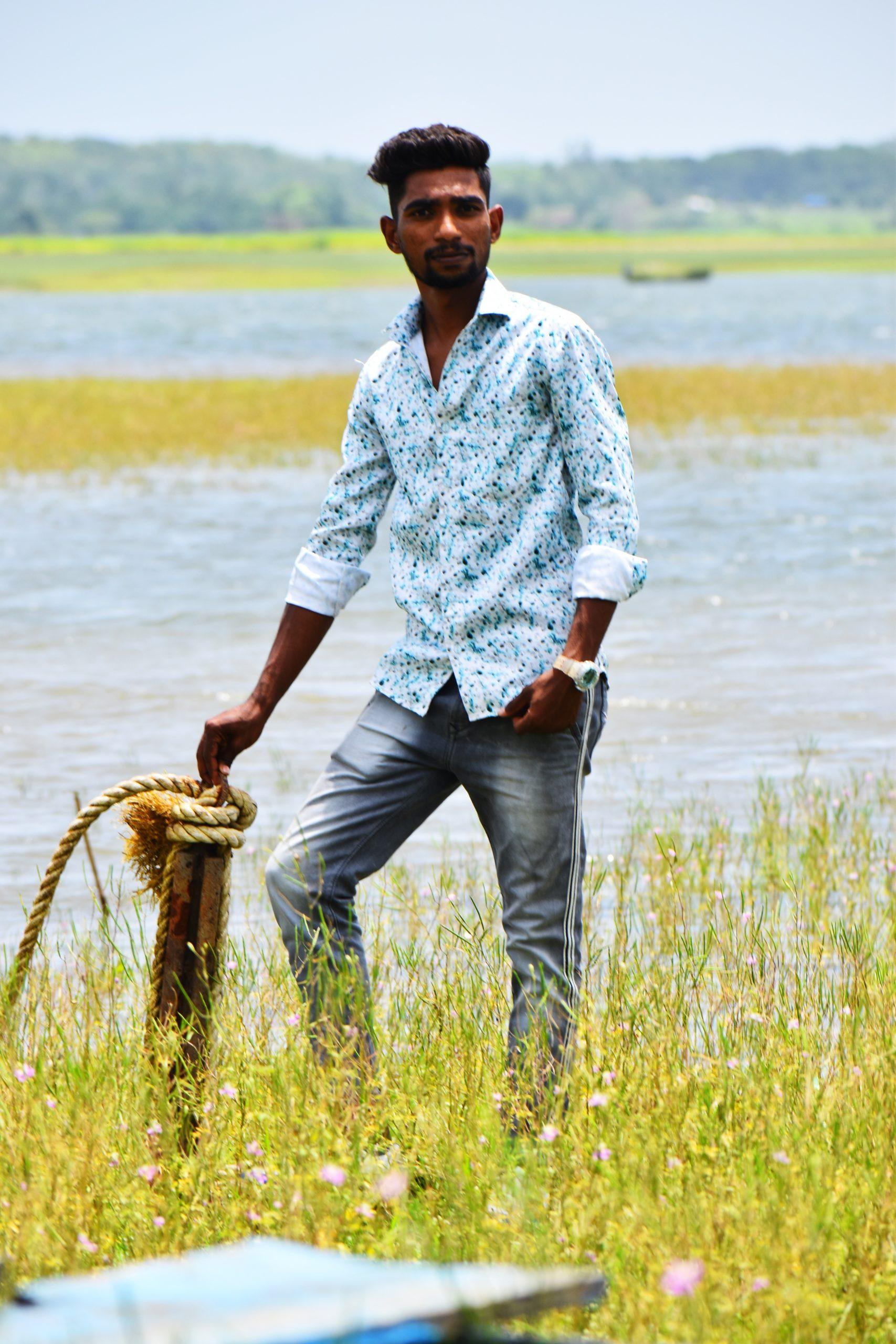 Boy posing near lake
