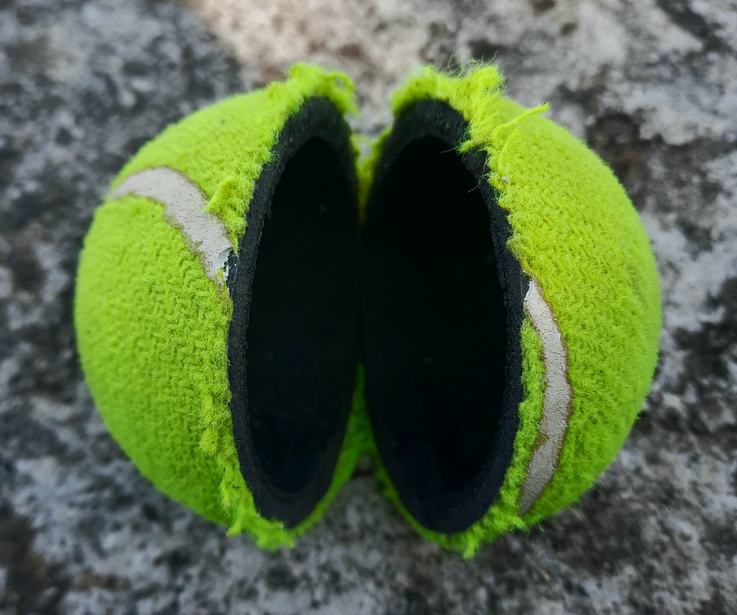 A broken tennis ball