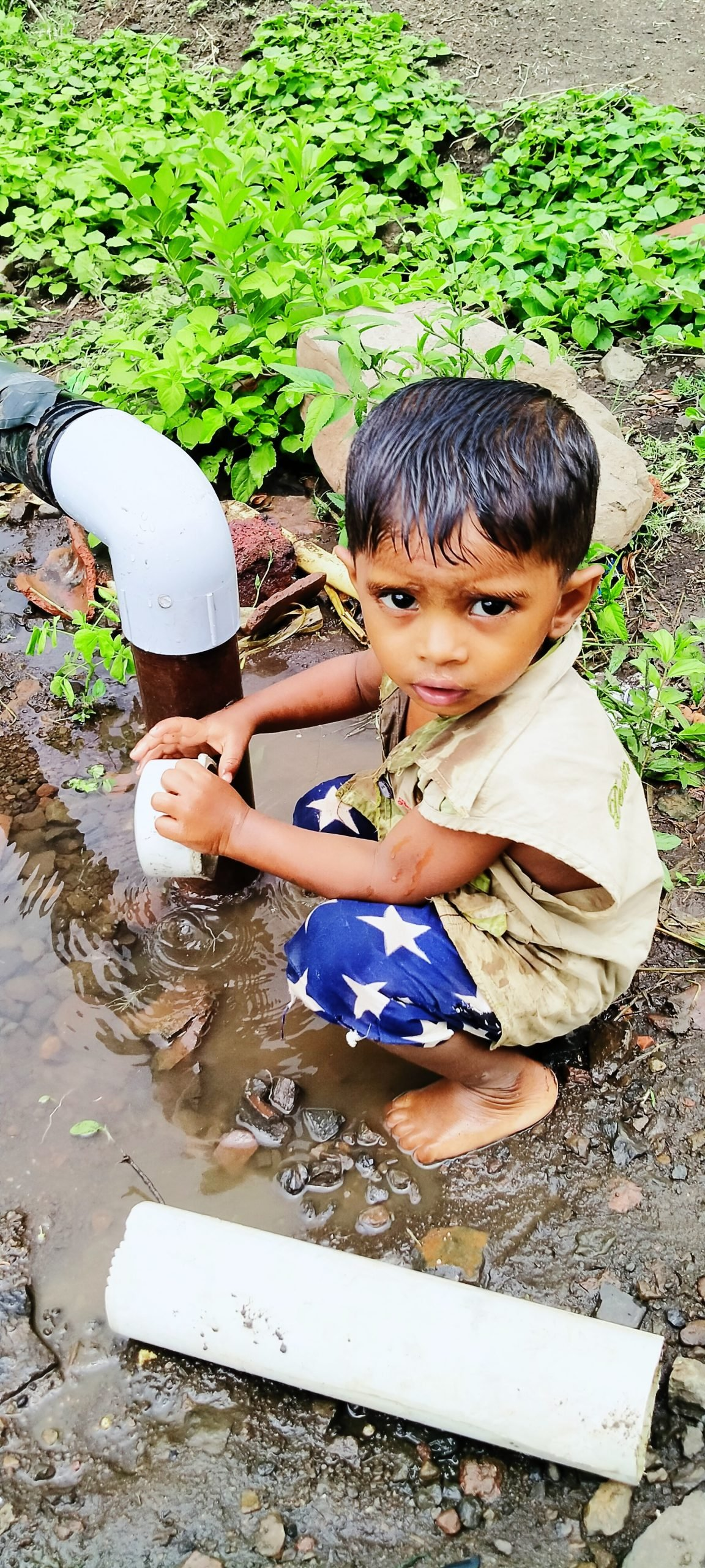A kid playing with water