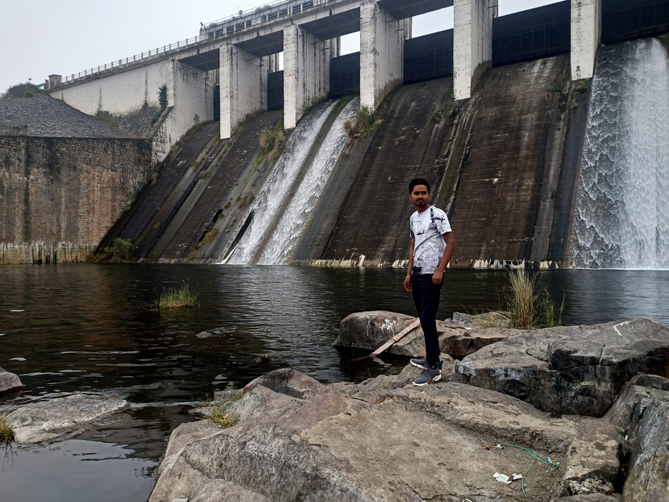 Boy posing under the dam