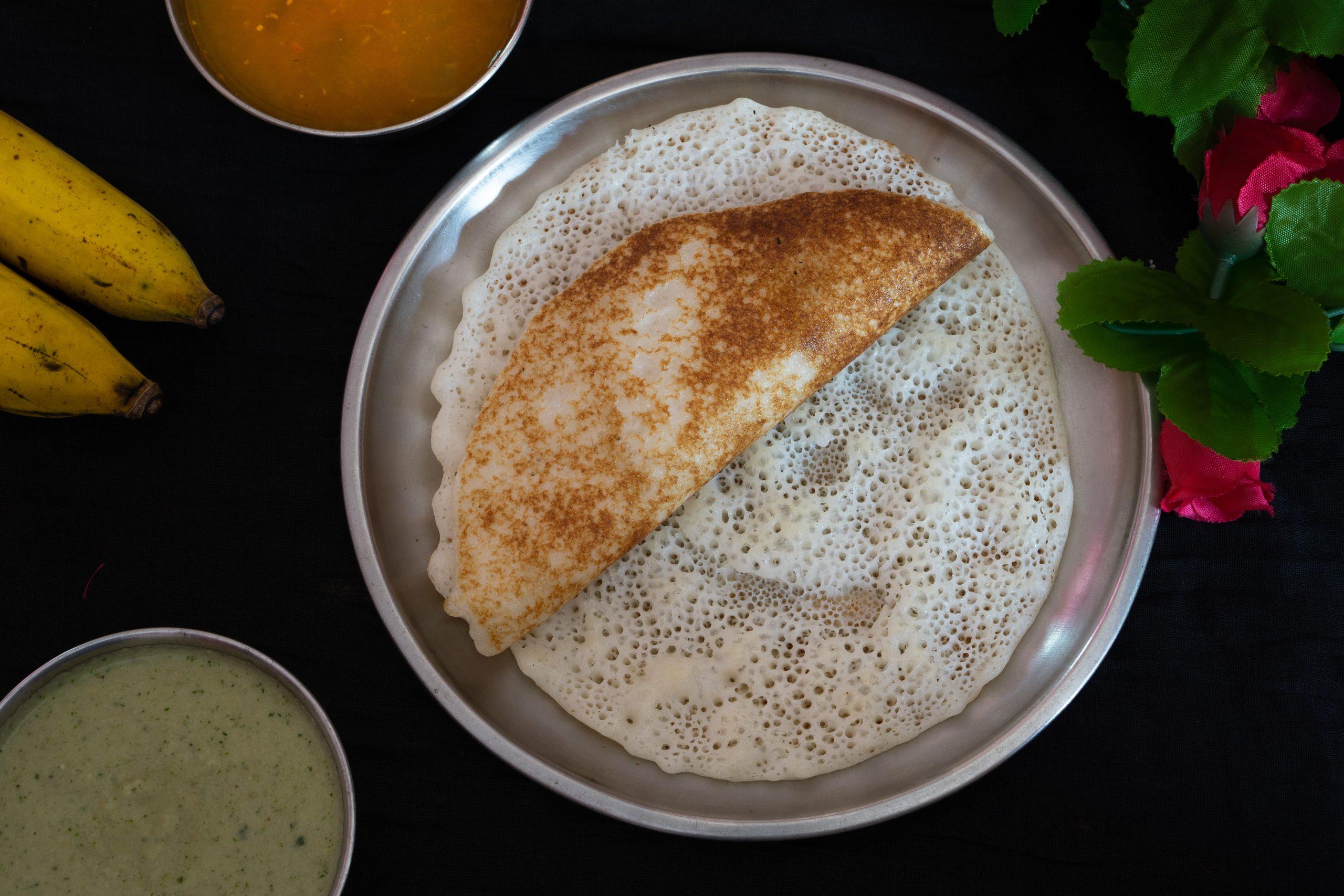 dosa with sambar, chutney and bananas