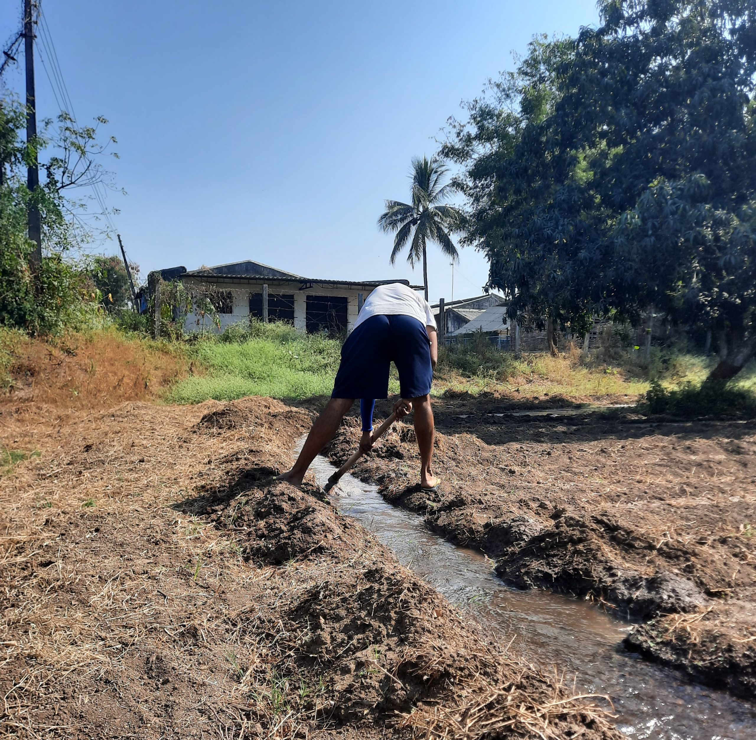 A farmer making waterway to his fields