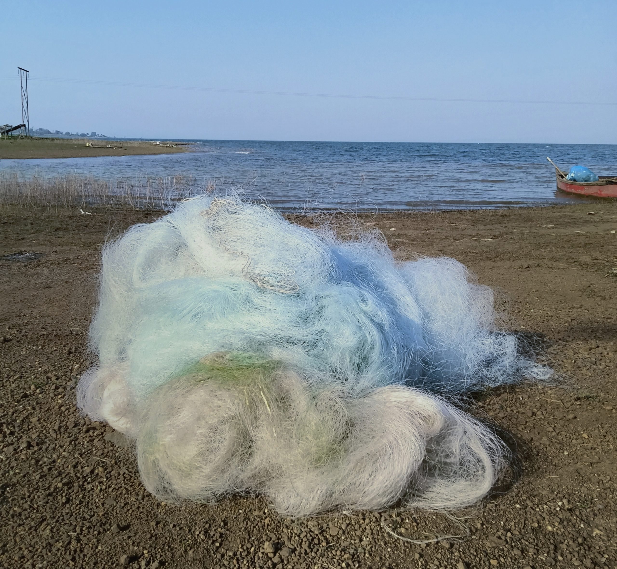 White fisher net at the side of the beach