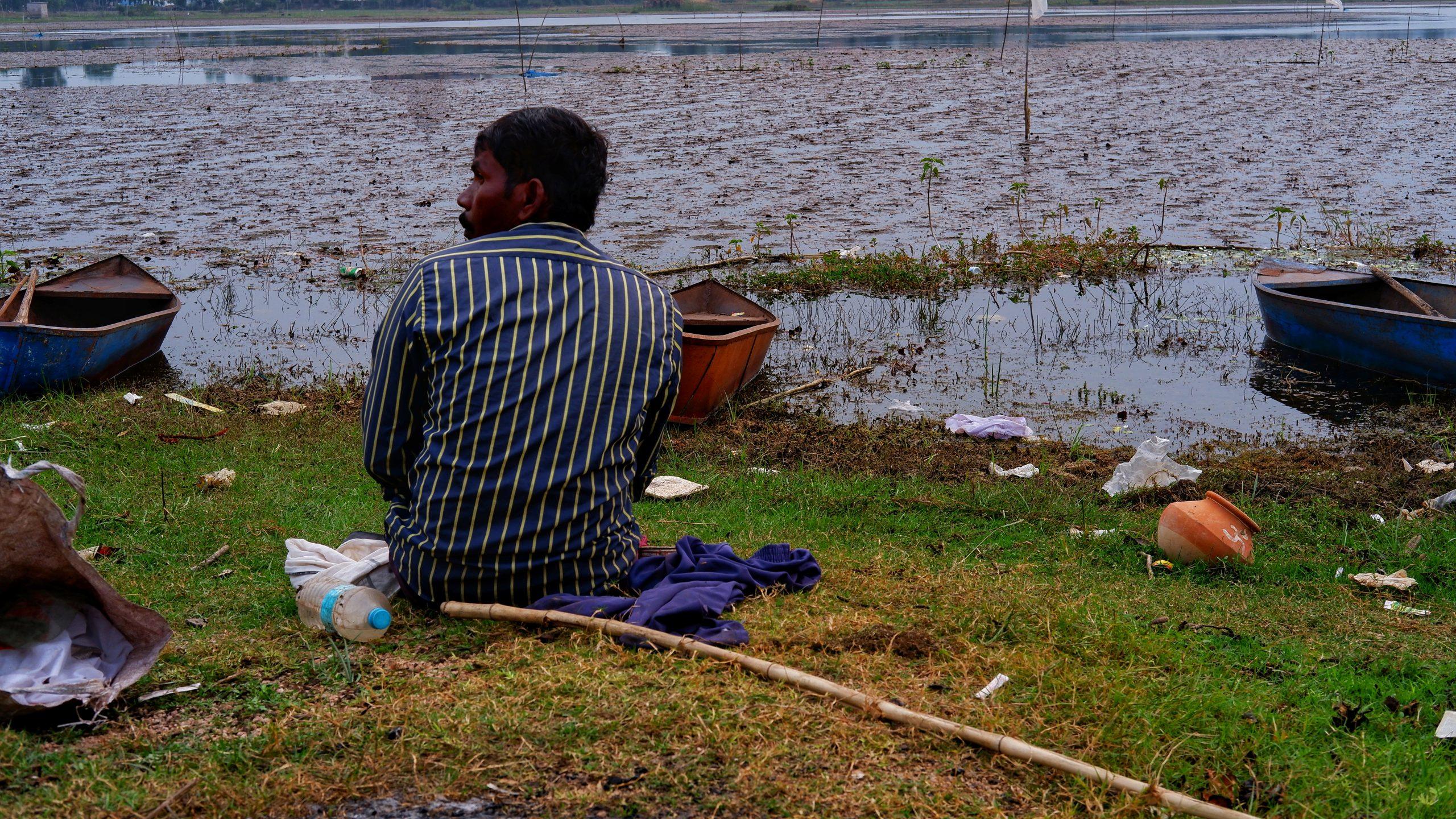 A fisherman at riverbank