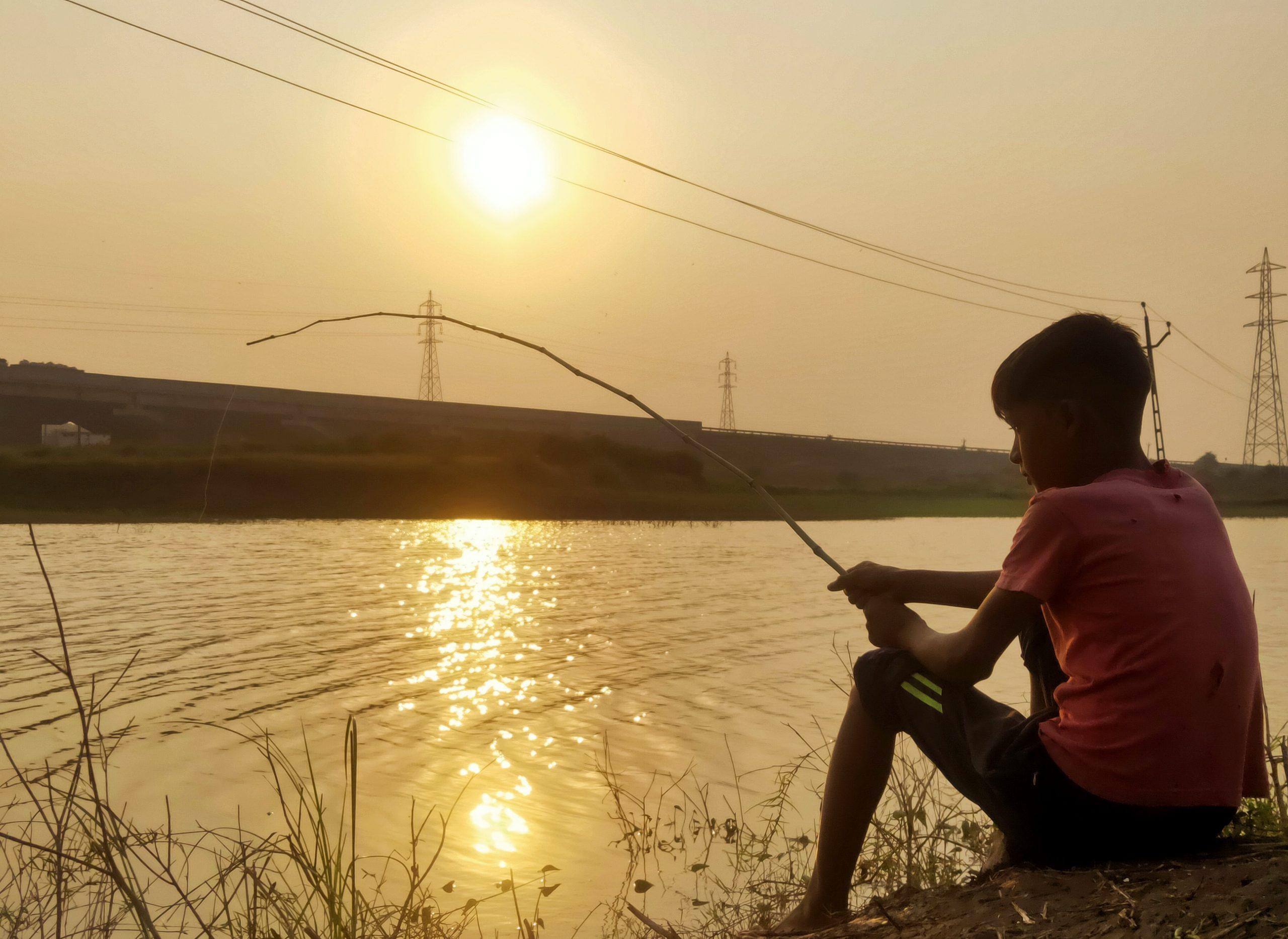 boy fishing at the sea