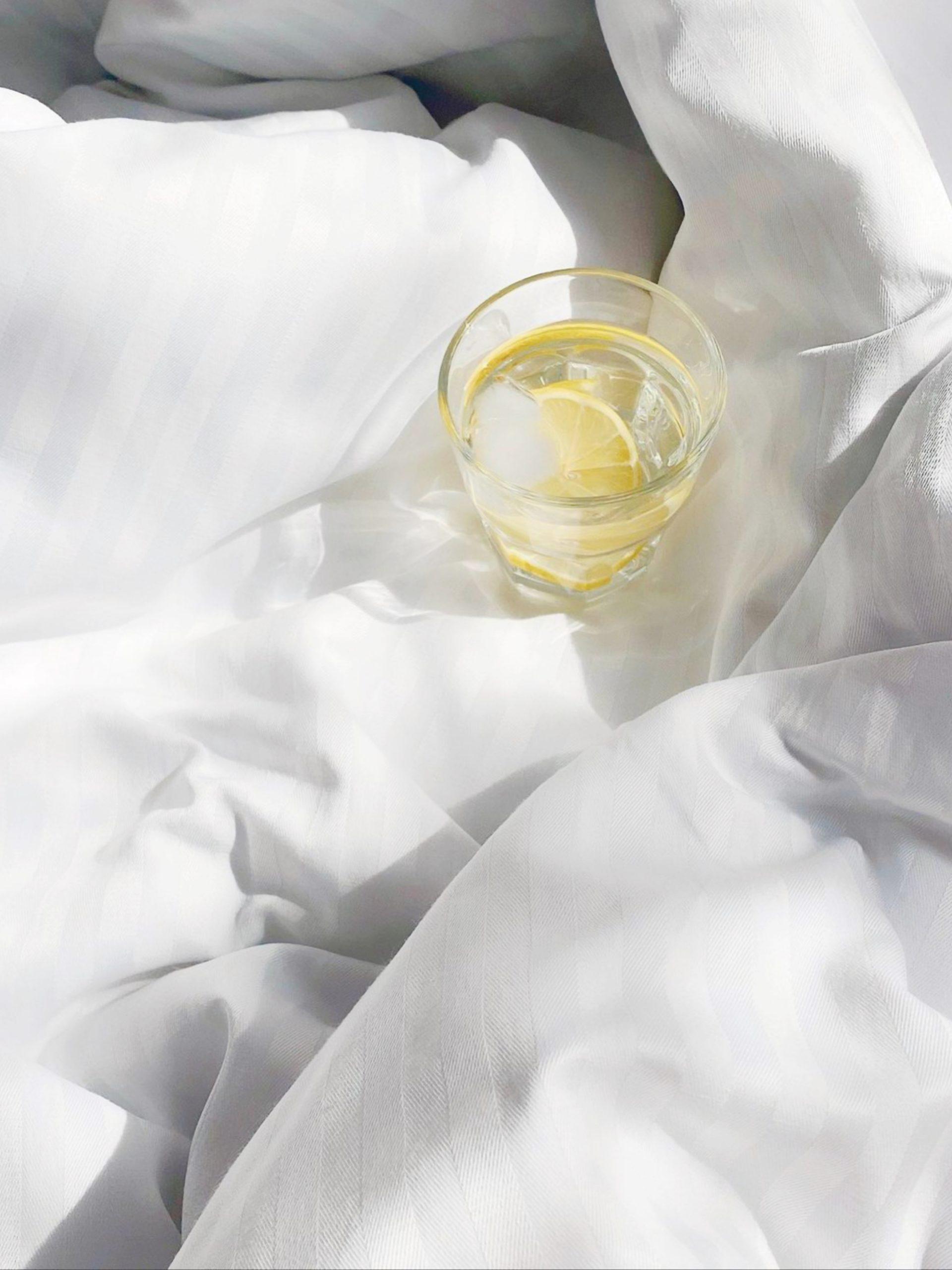 Lemon tea on bed