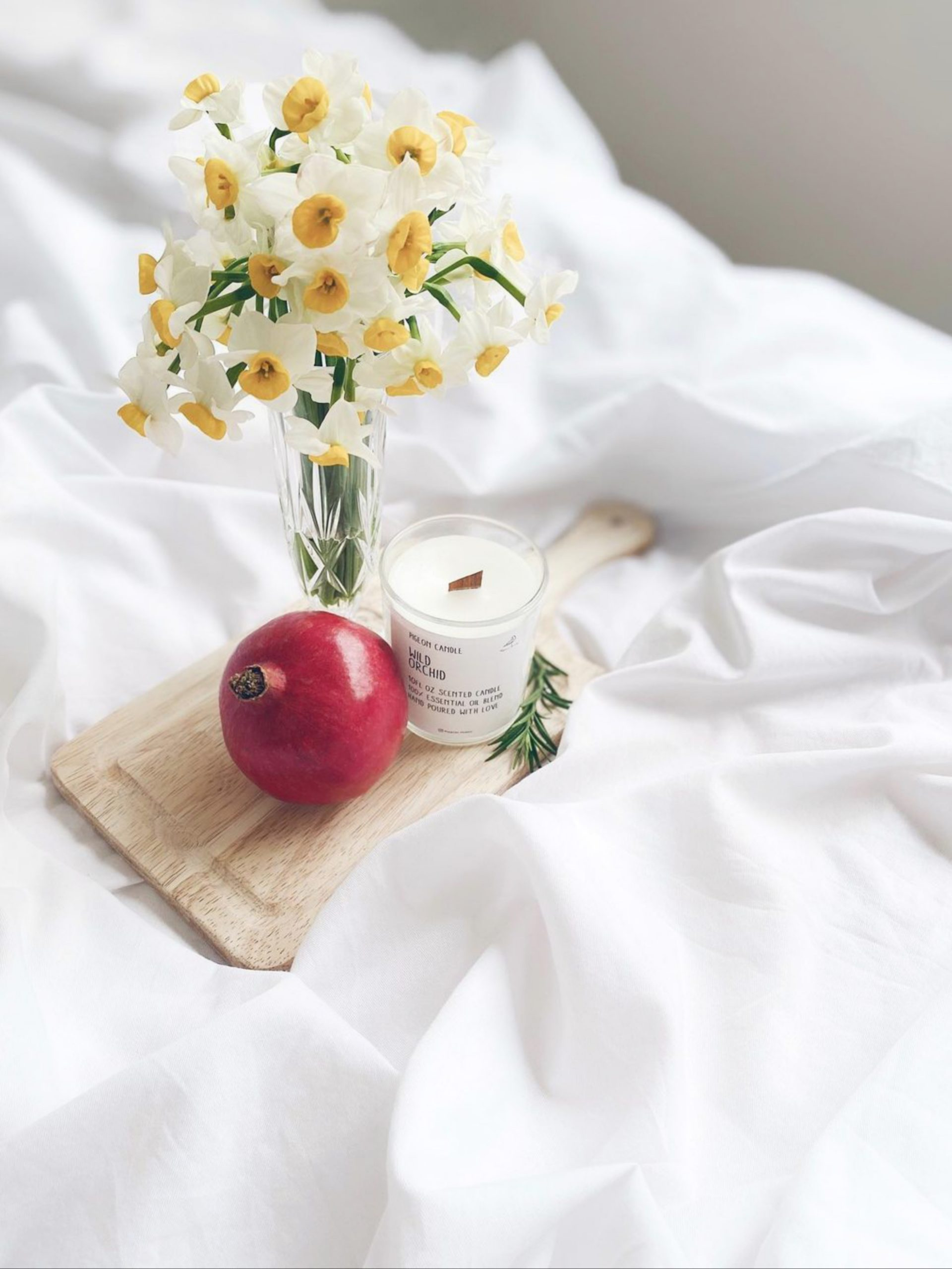 Flower pot with pomegranate on bed