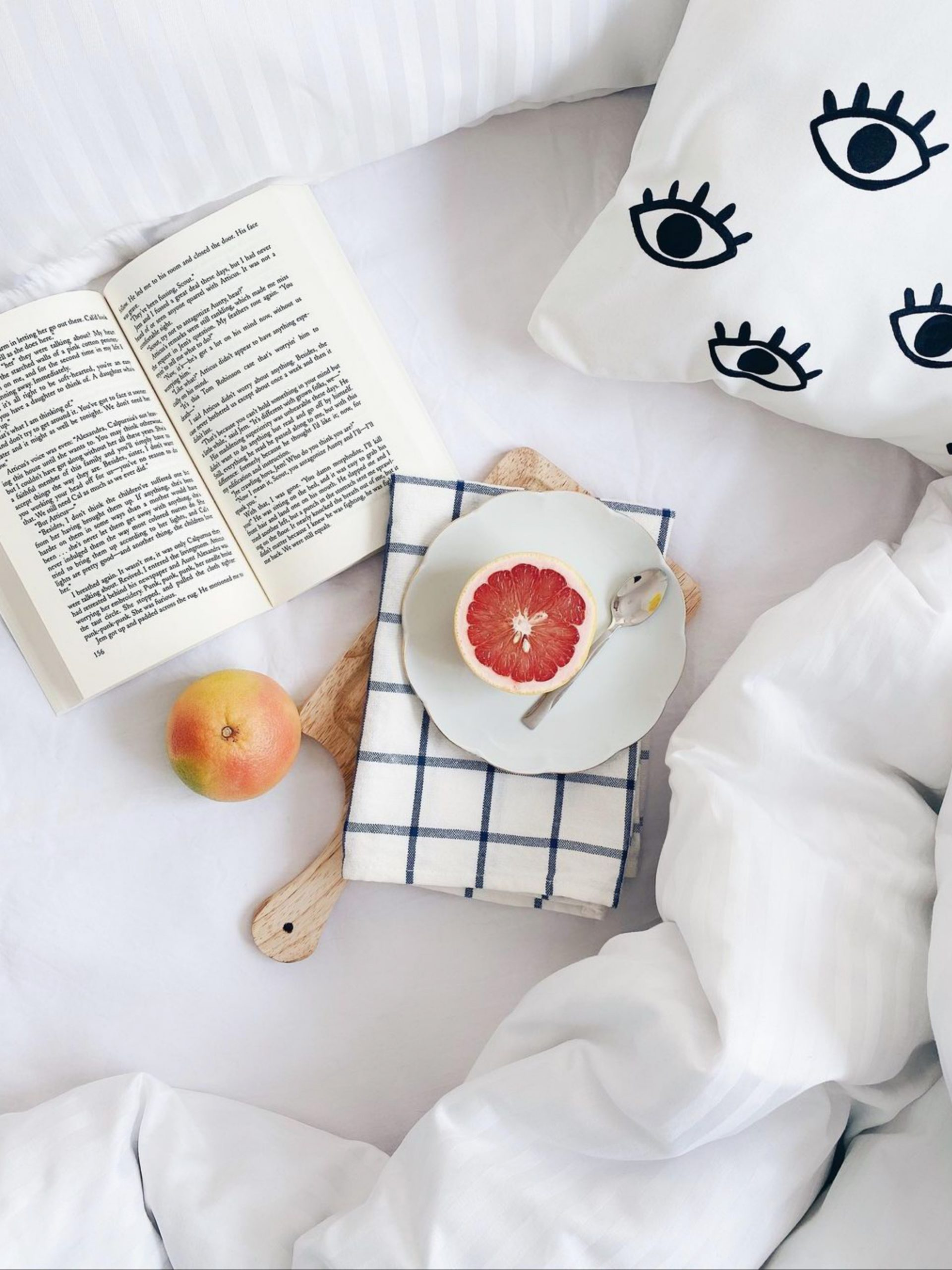 Fruit on the bed with book