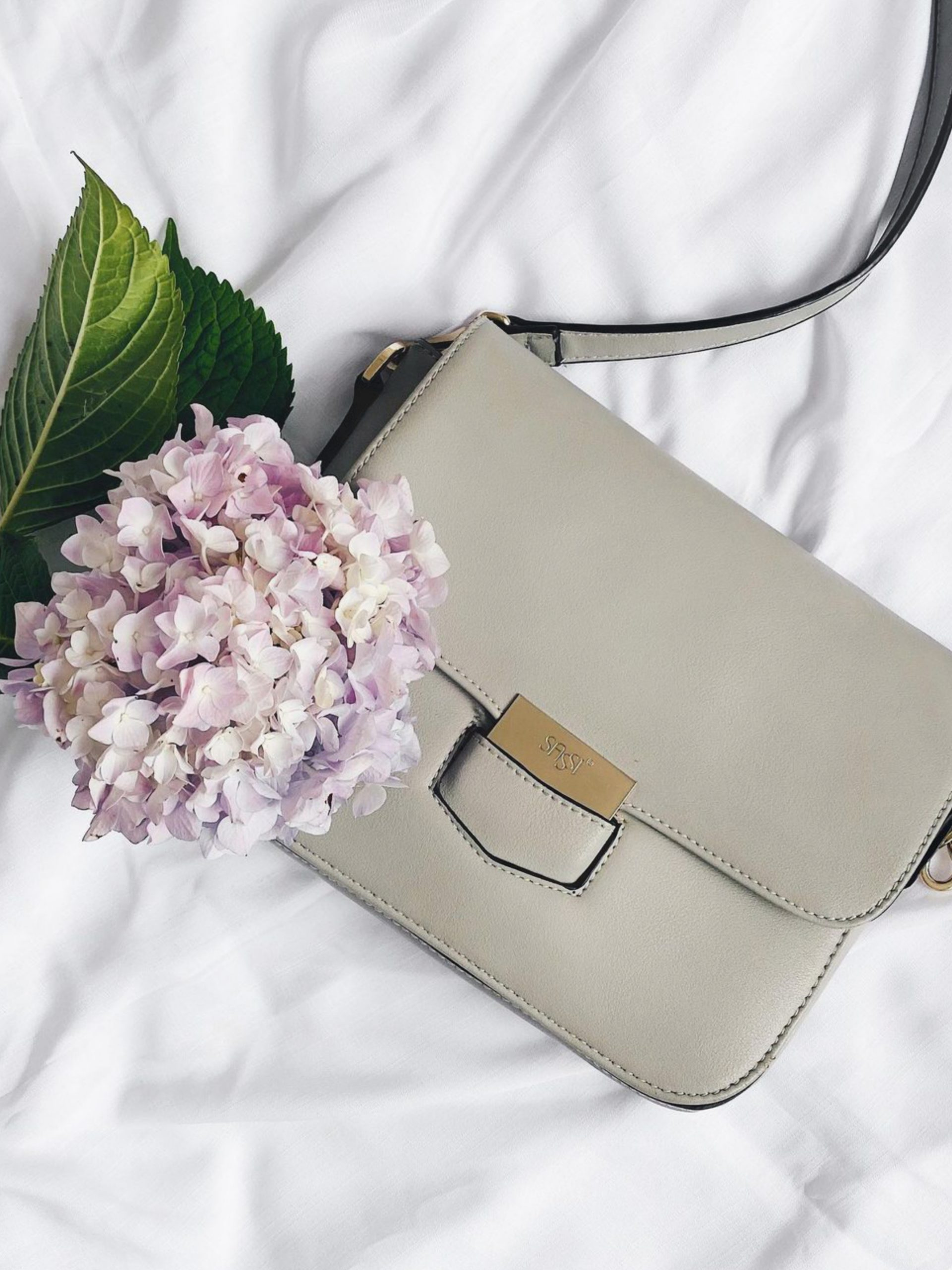 A lady purse and flowers