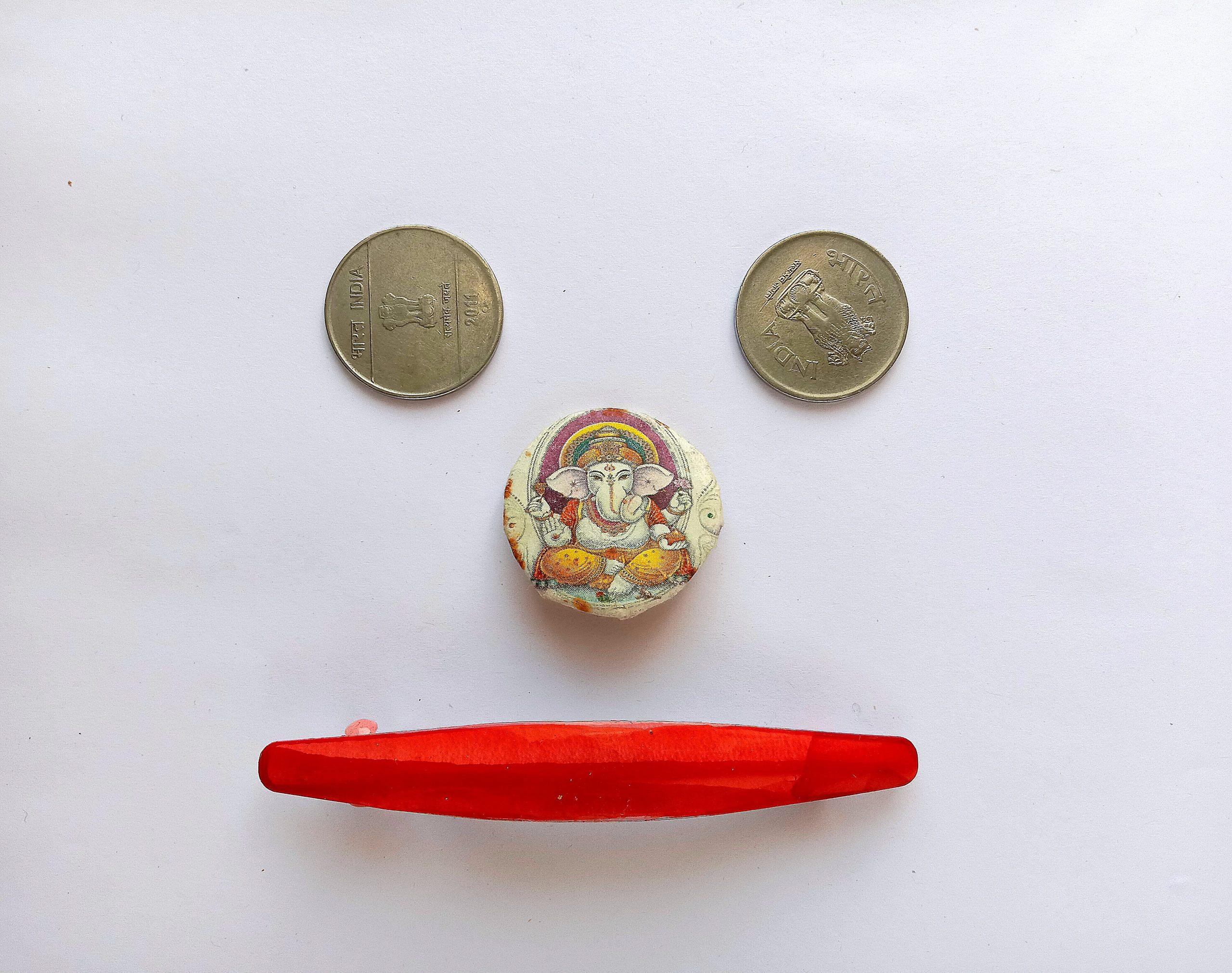Ganpati Murti with coin