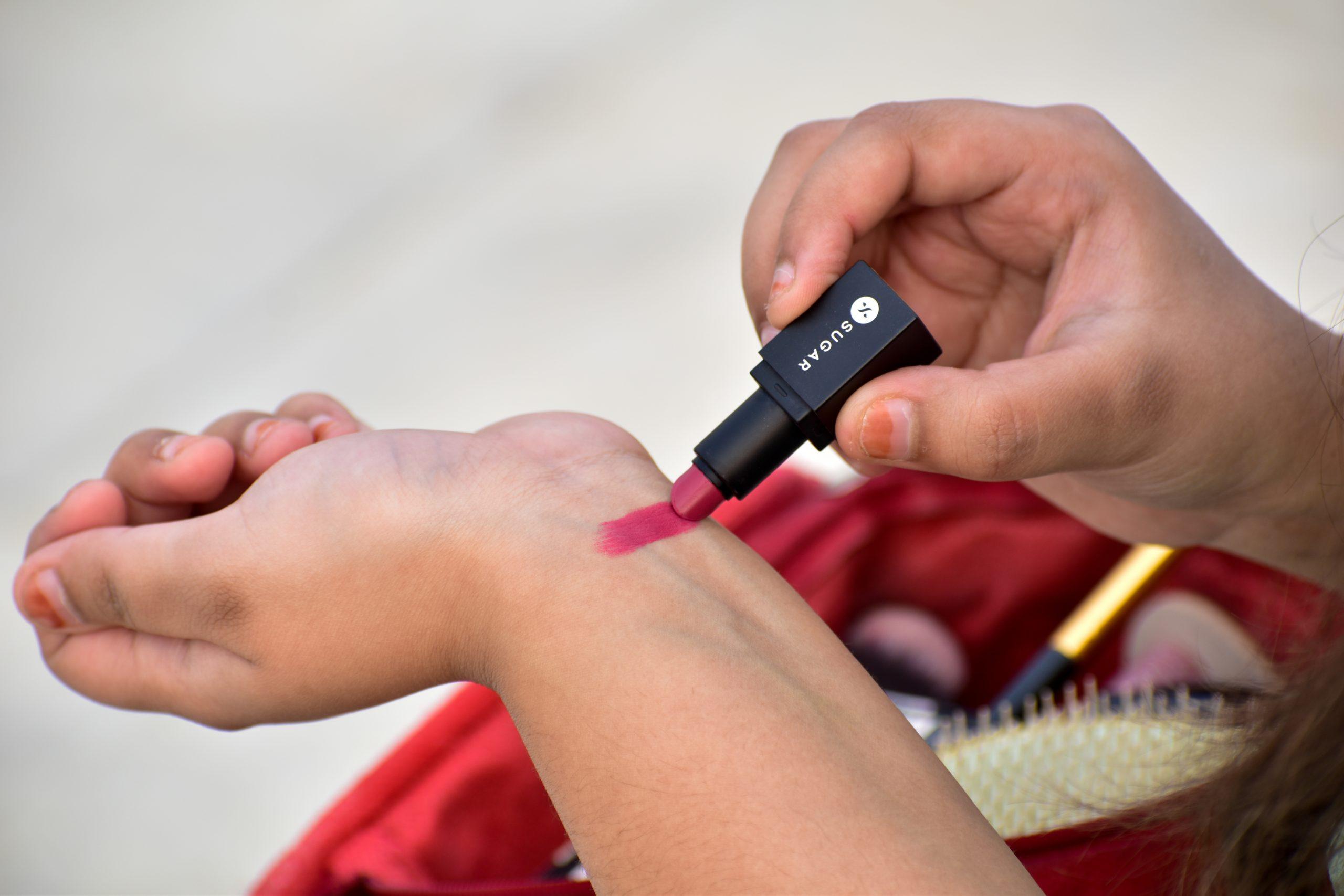 A girl testing lip stick