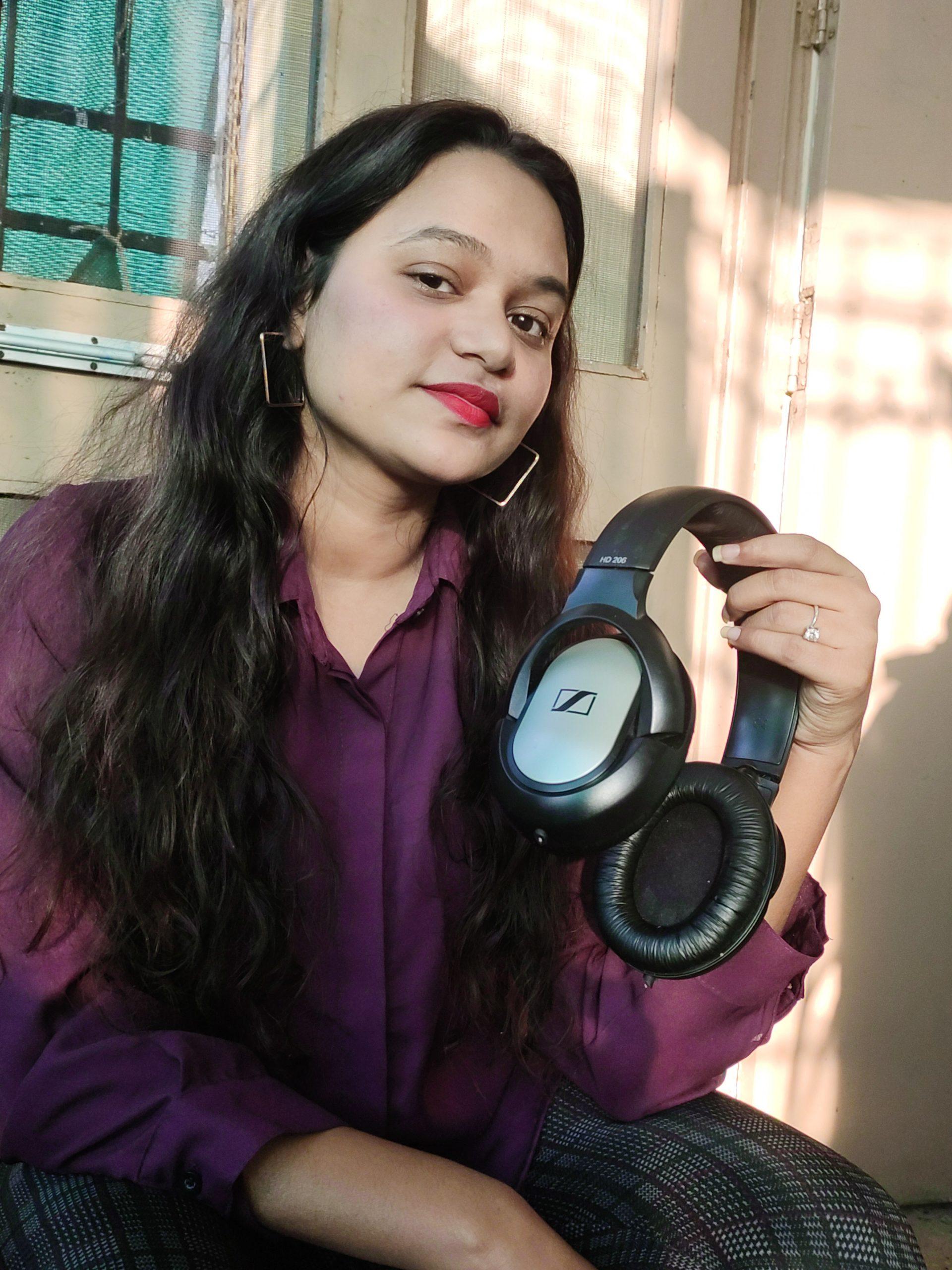 girl holding headphone