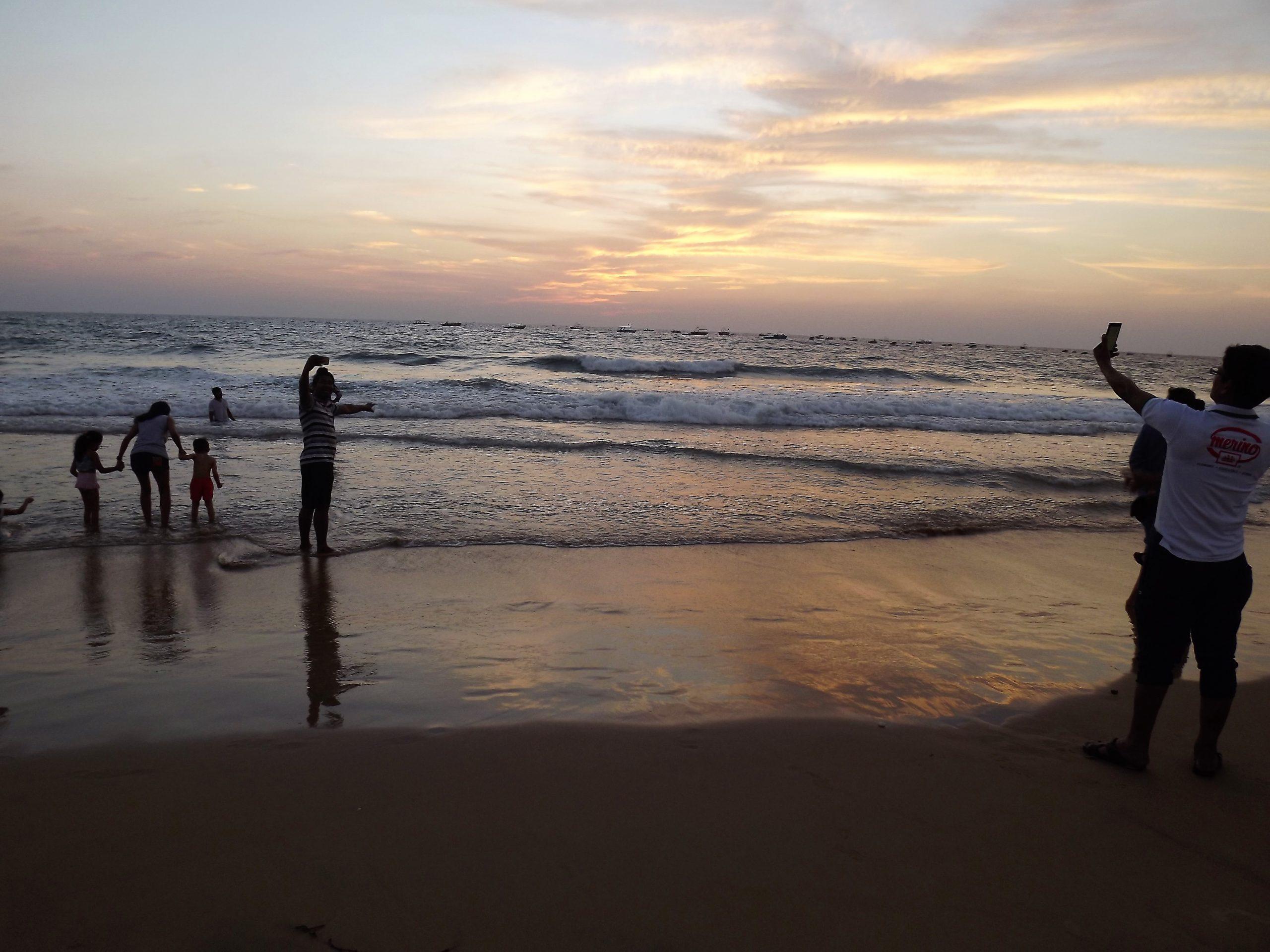 Visitors enjoying sunset at the beach