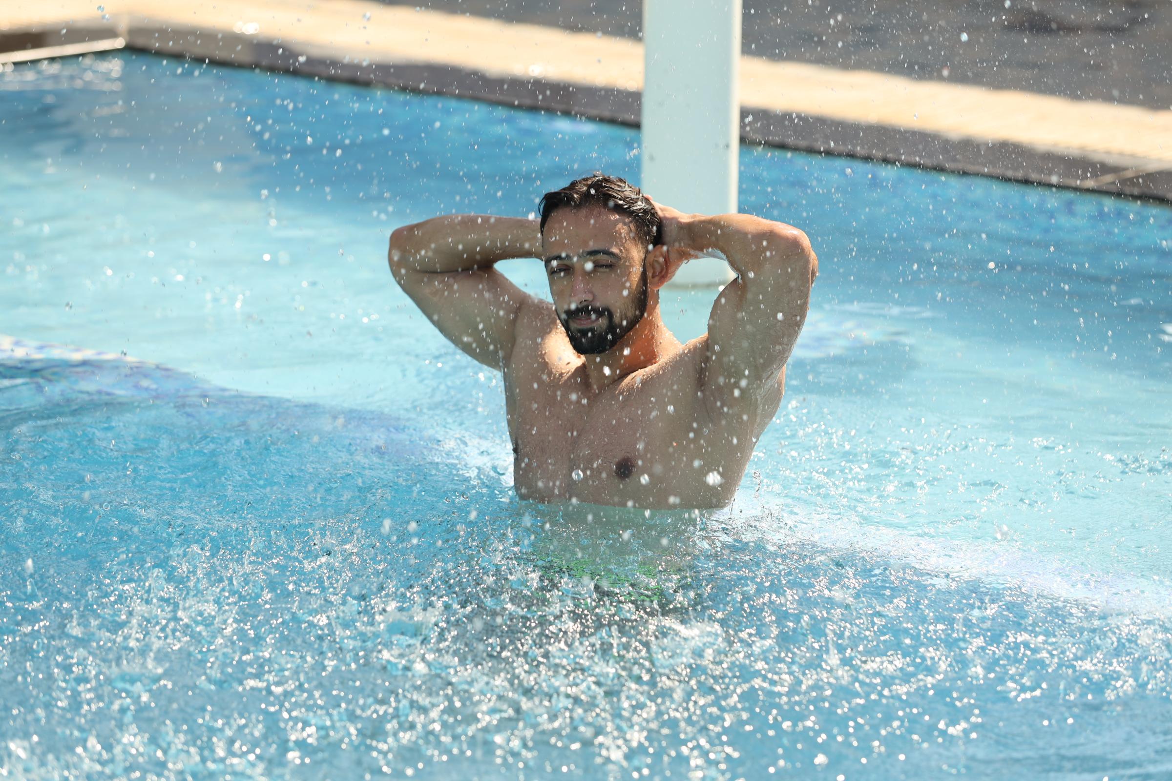Guy posing in swimming pool