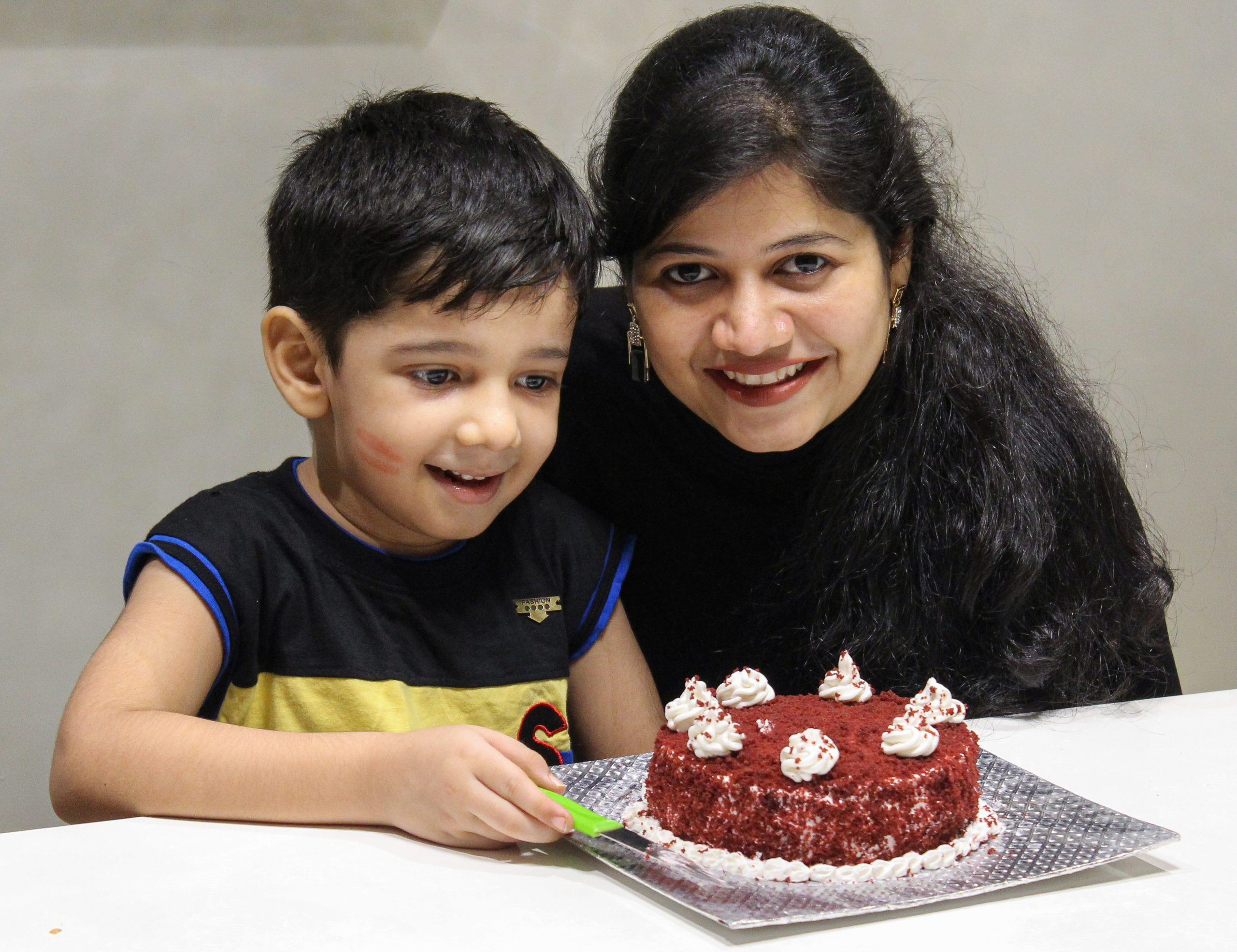 A mother celebrating birthday of her son