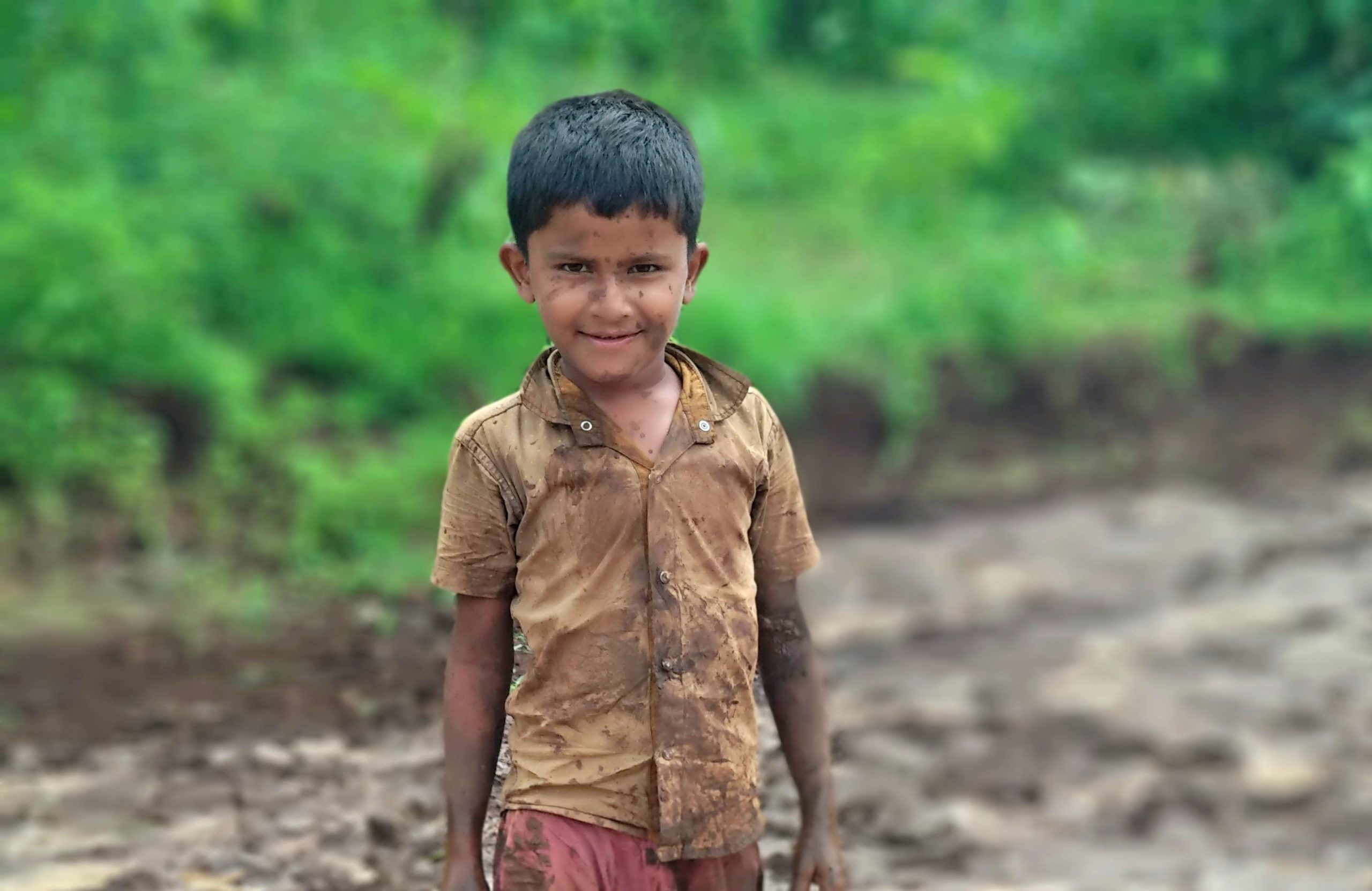 Kid playing in a mud