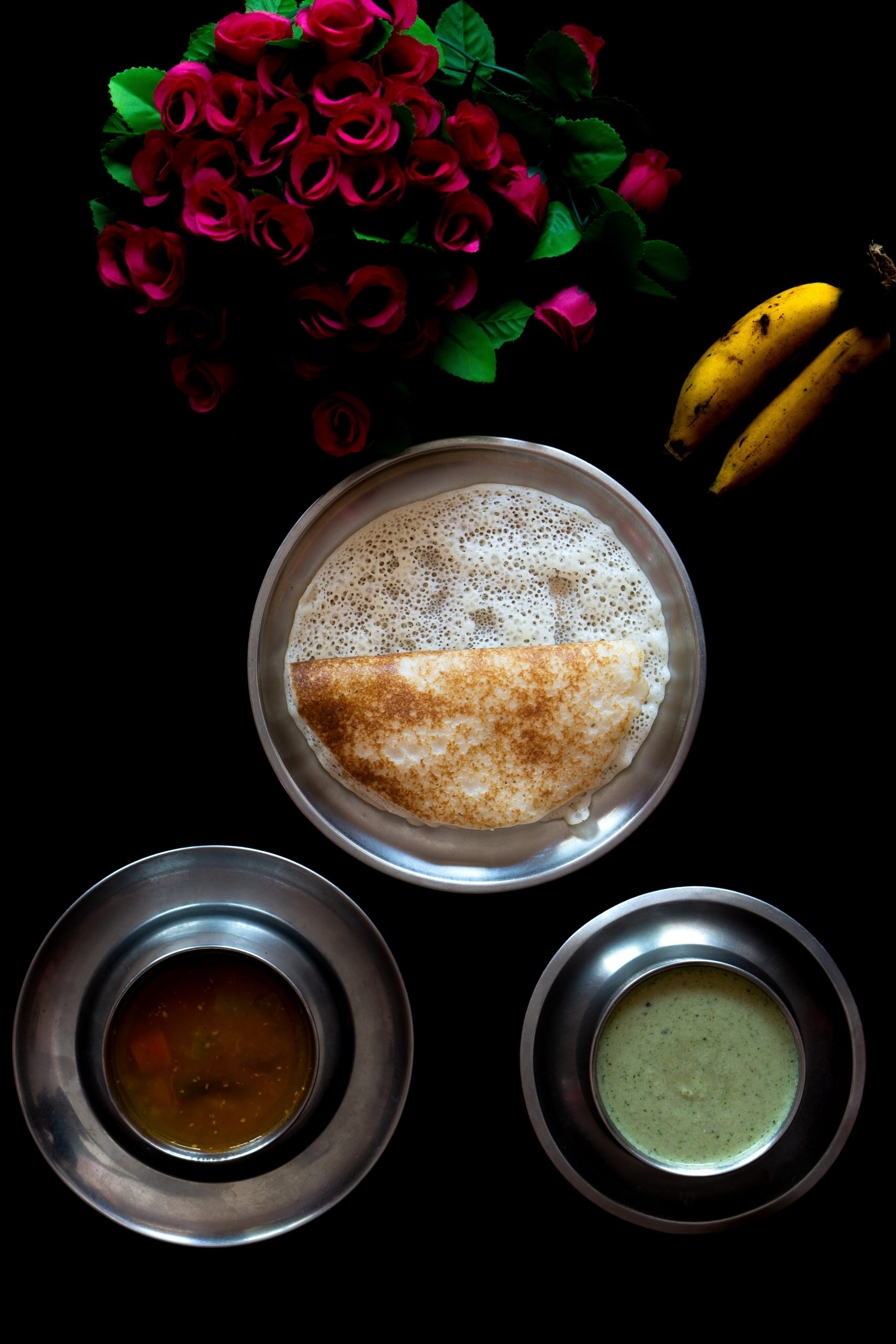 dosa with sambar, chutney and bananas