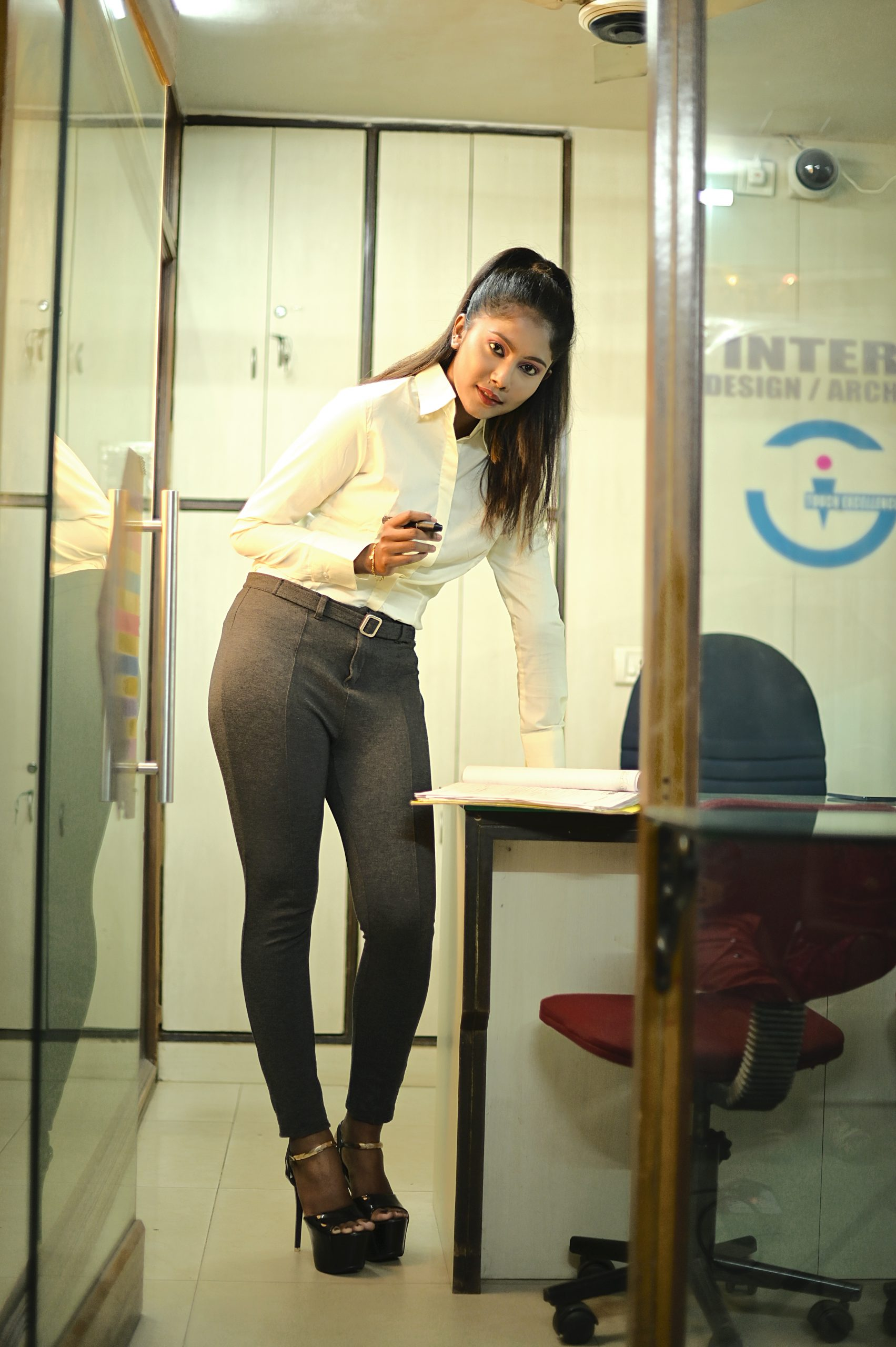 Girl posing in the office