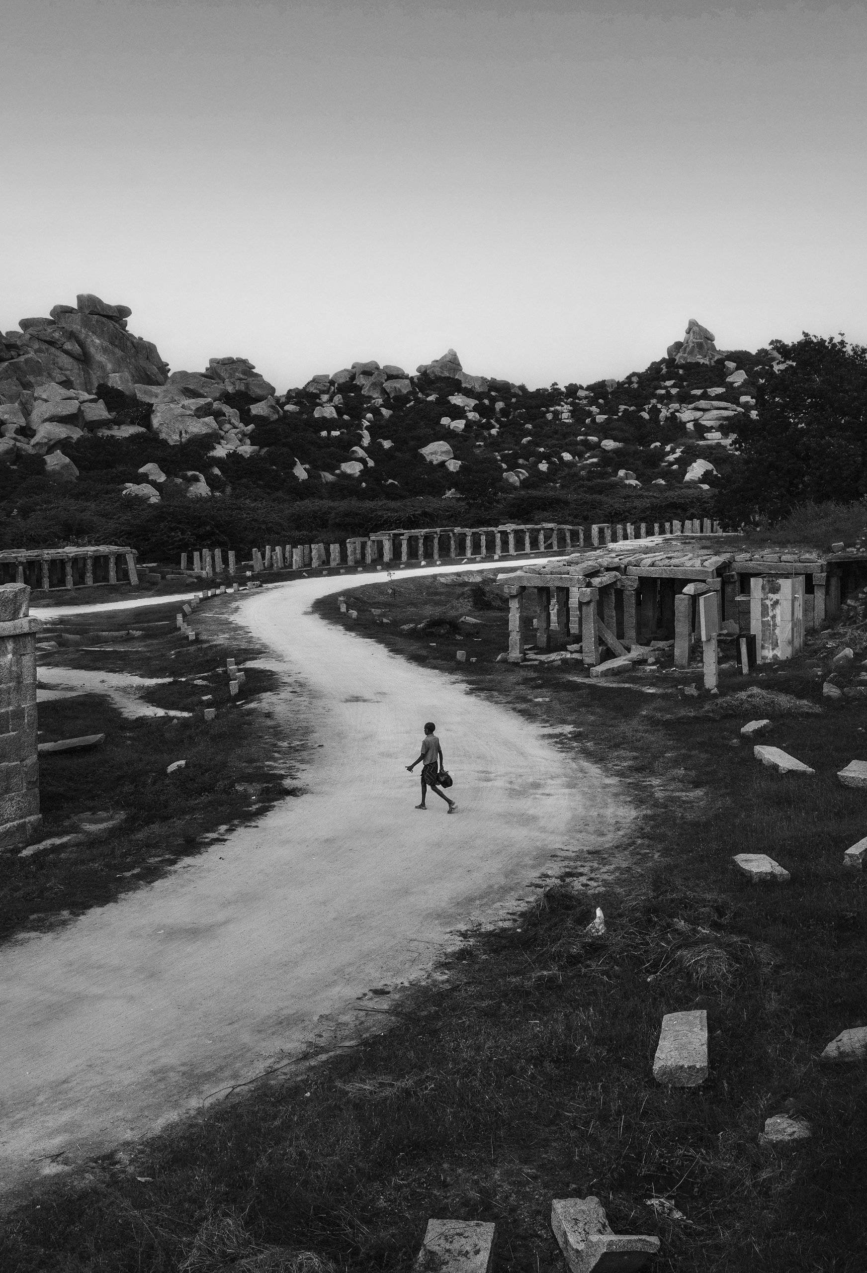 Person walking in the landslides of Hampi