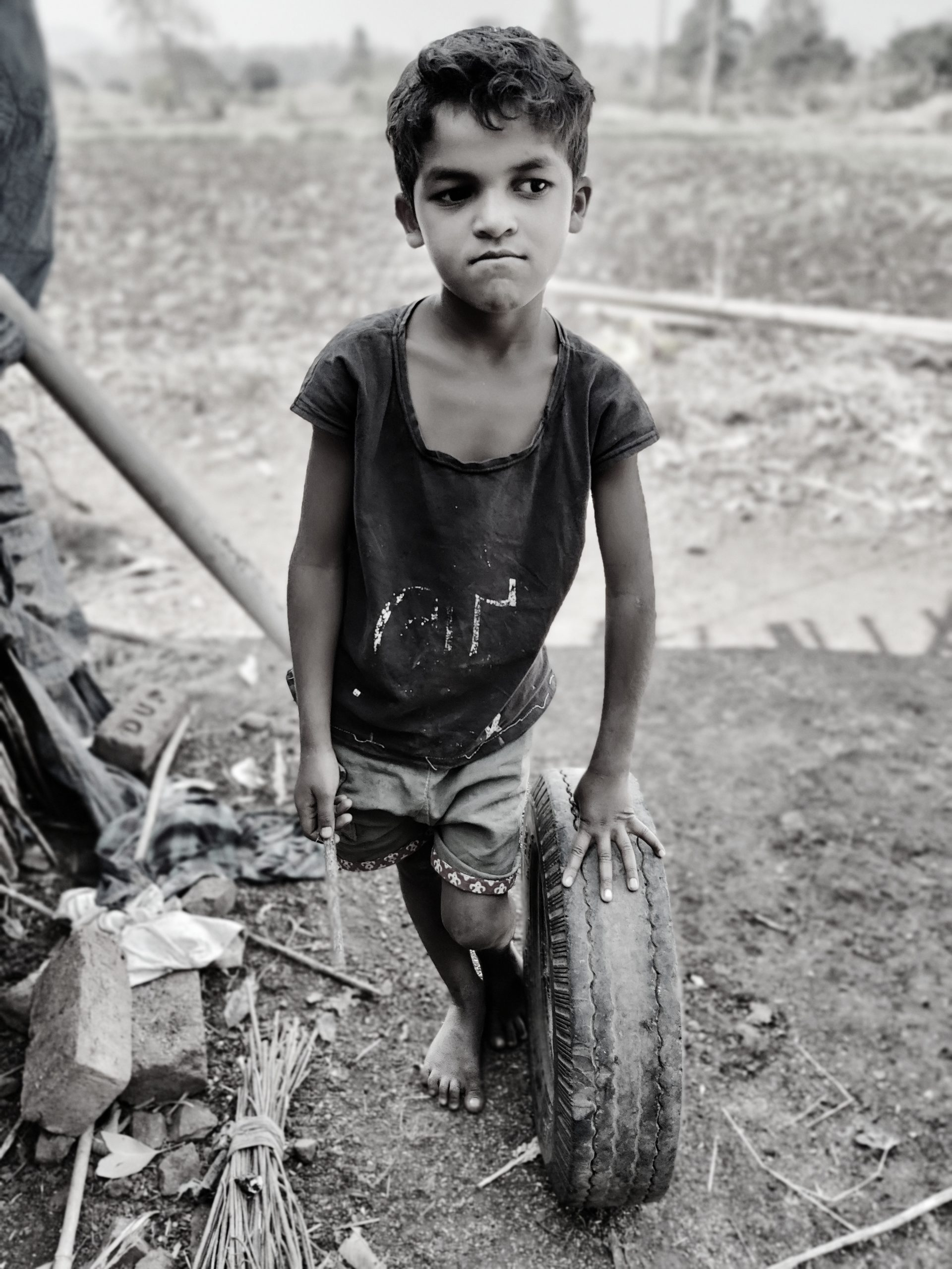 Boy Playing with Tire