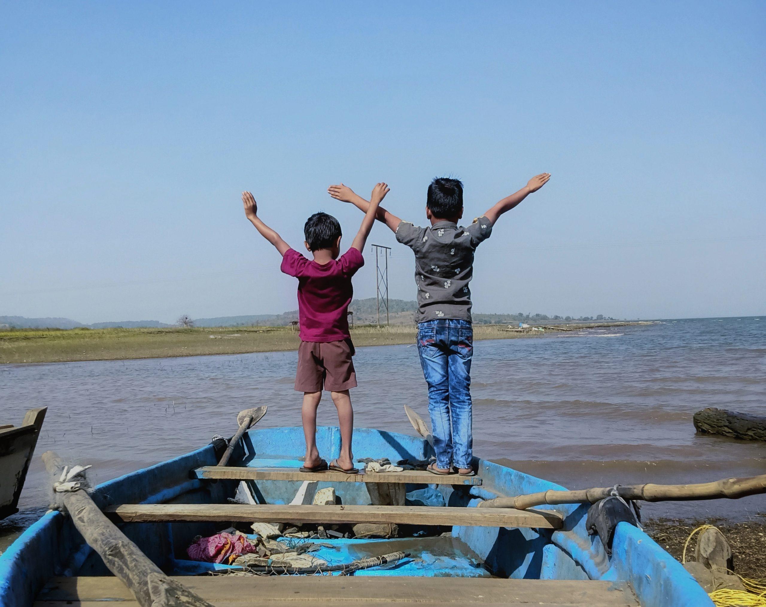 Kids posing on boat