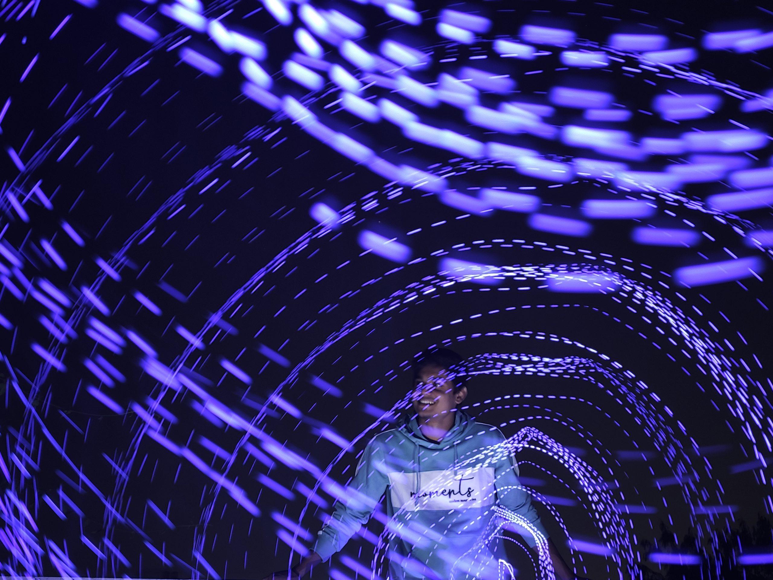 A boy in spiral lights