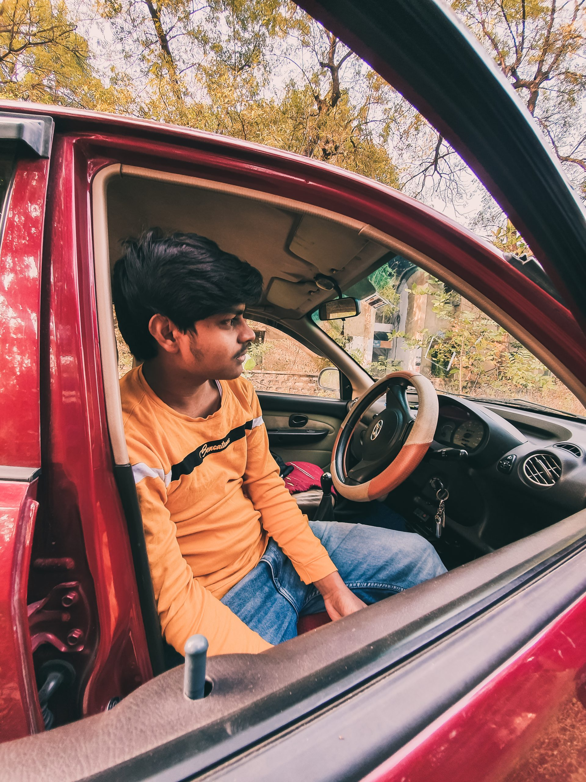 A boy in a car