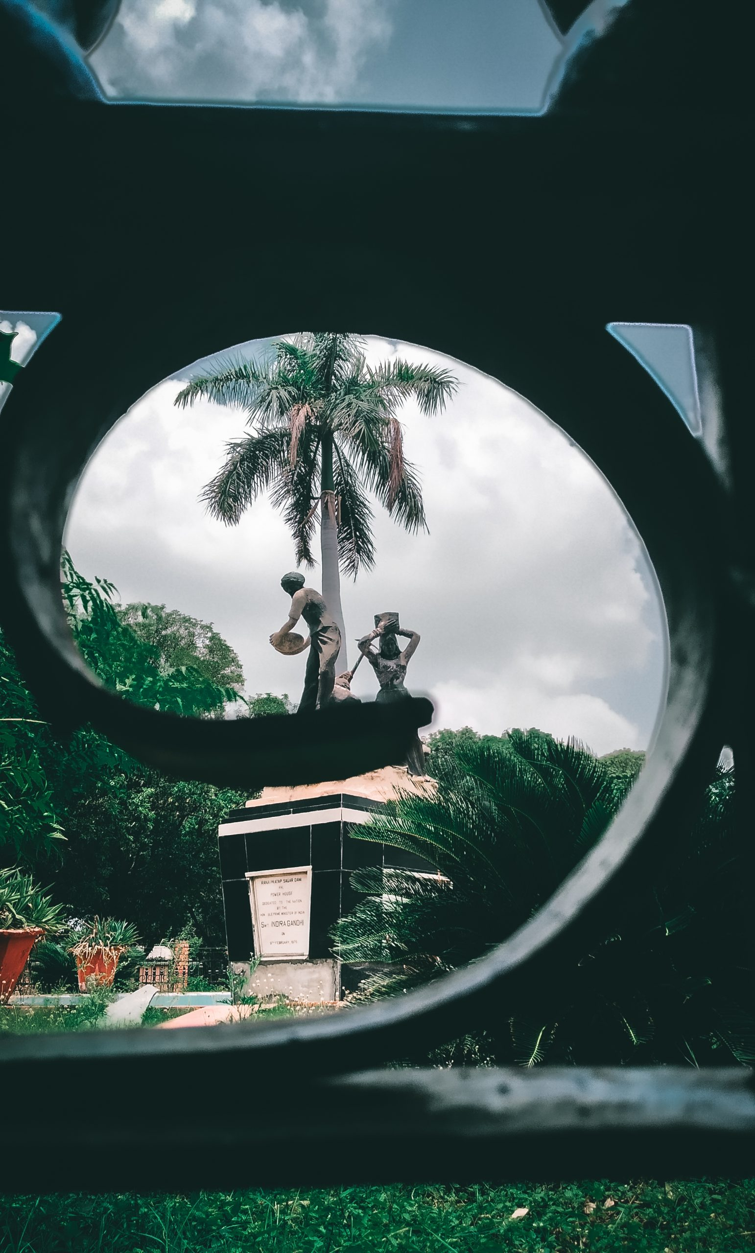 Workers statues through iron angle
