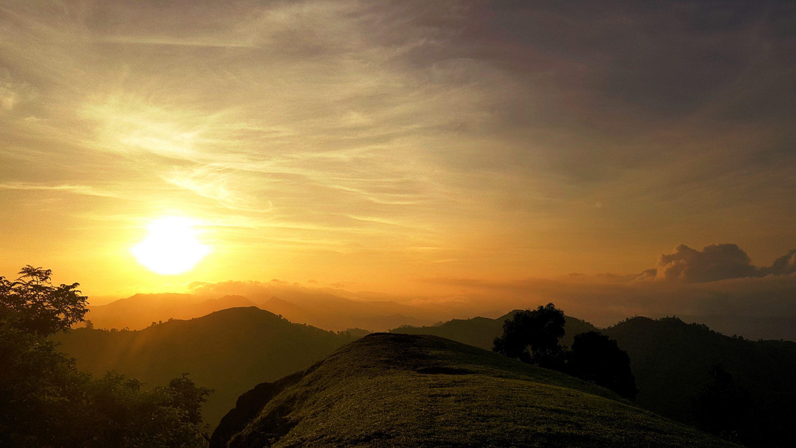 Sun shining on mountains