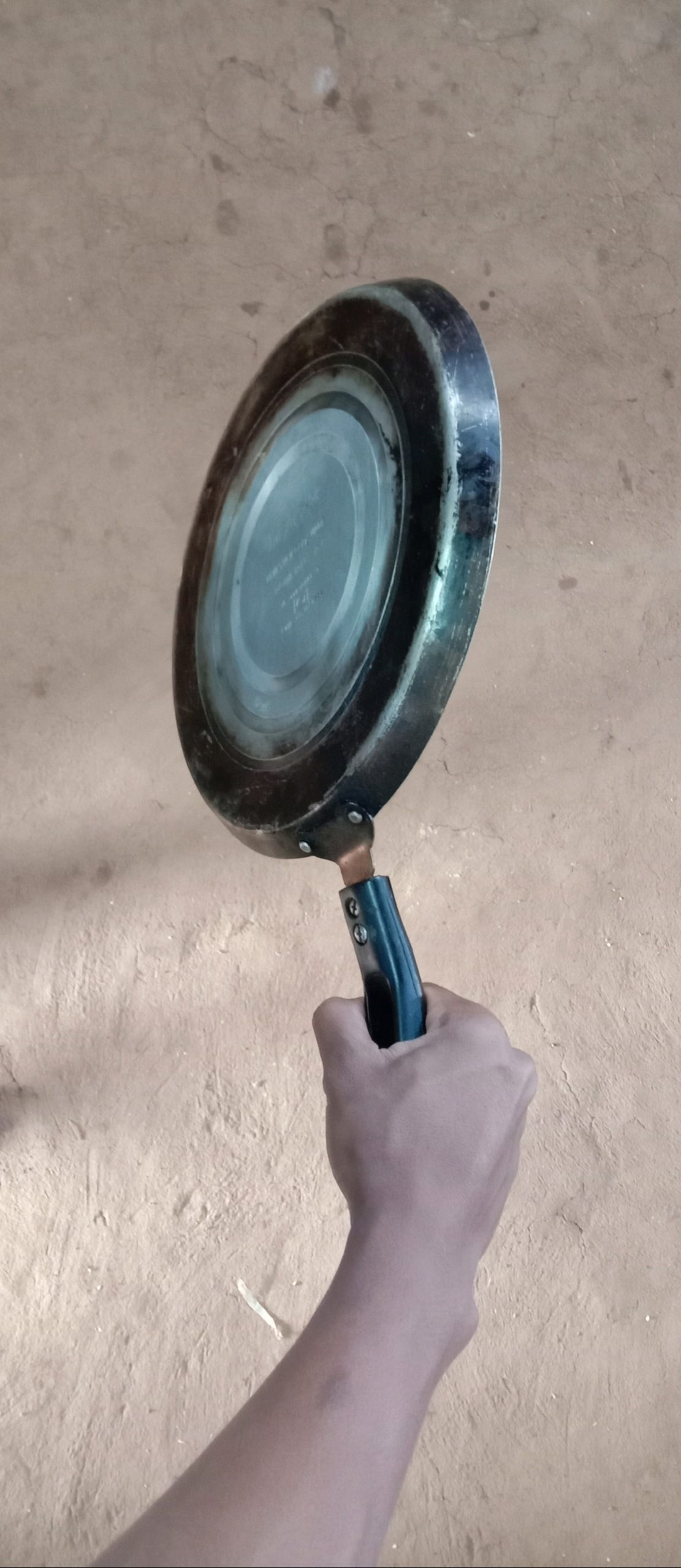 A pan in hand