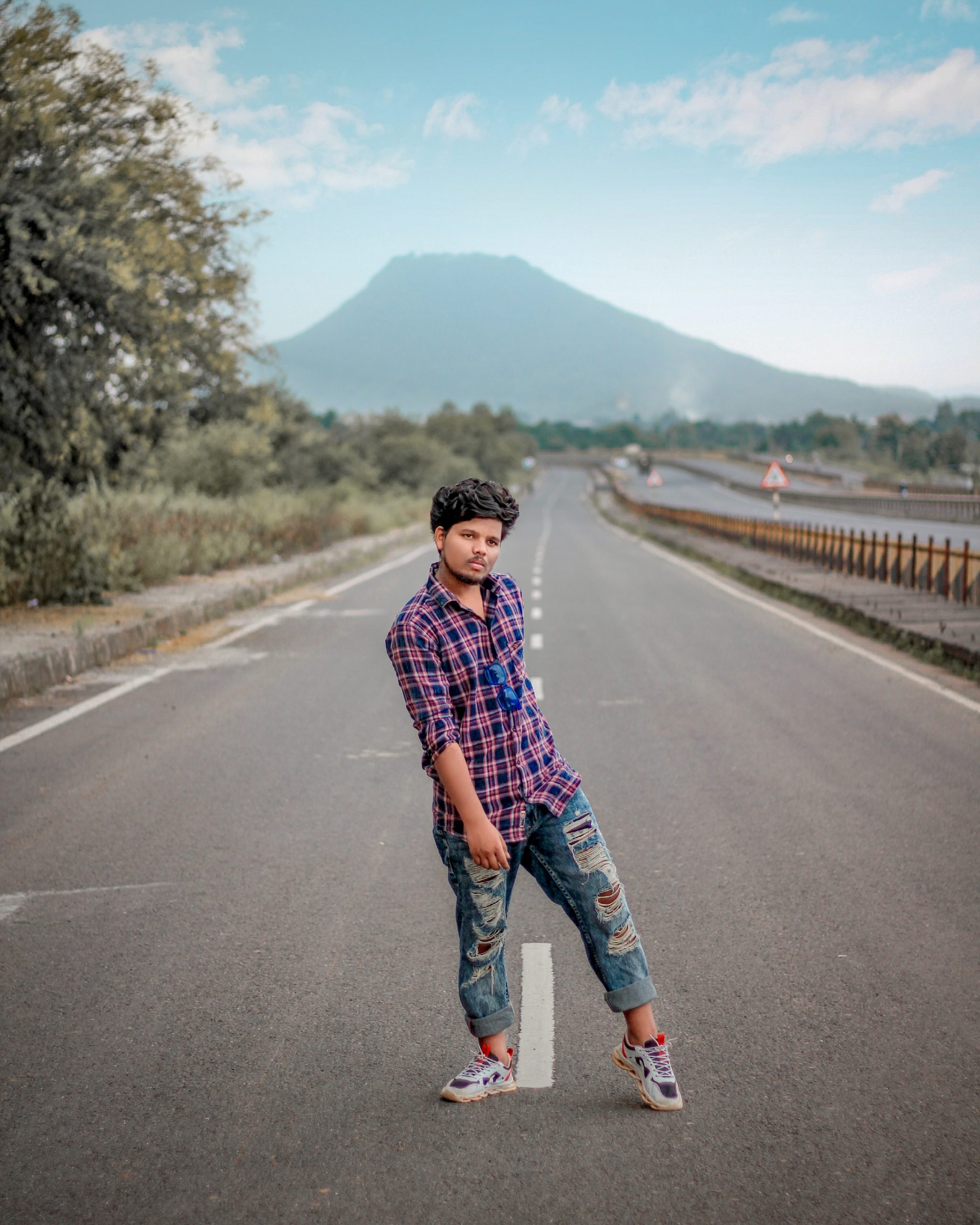 A boy in middle of highway
