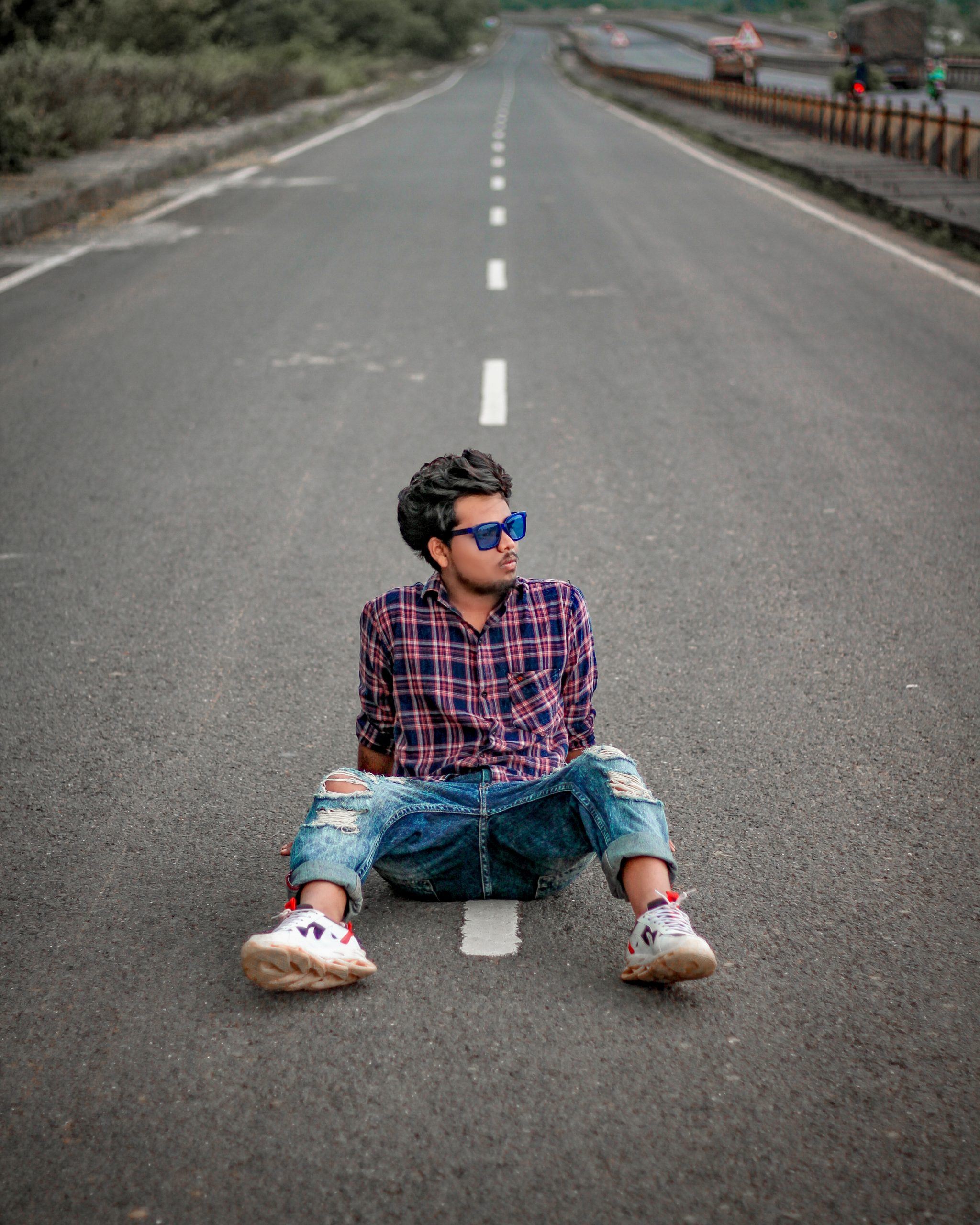 man posing on the road