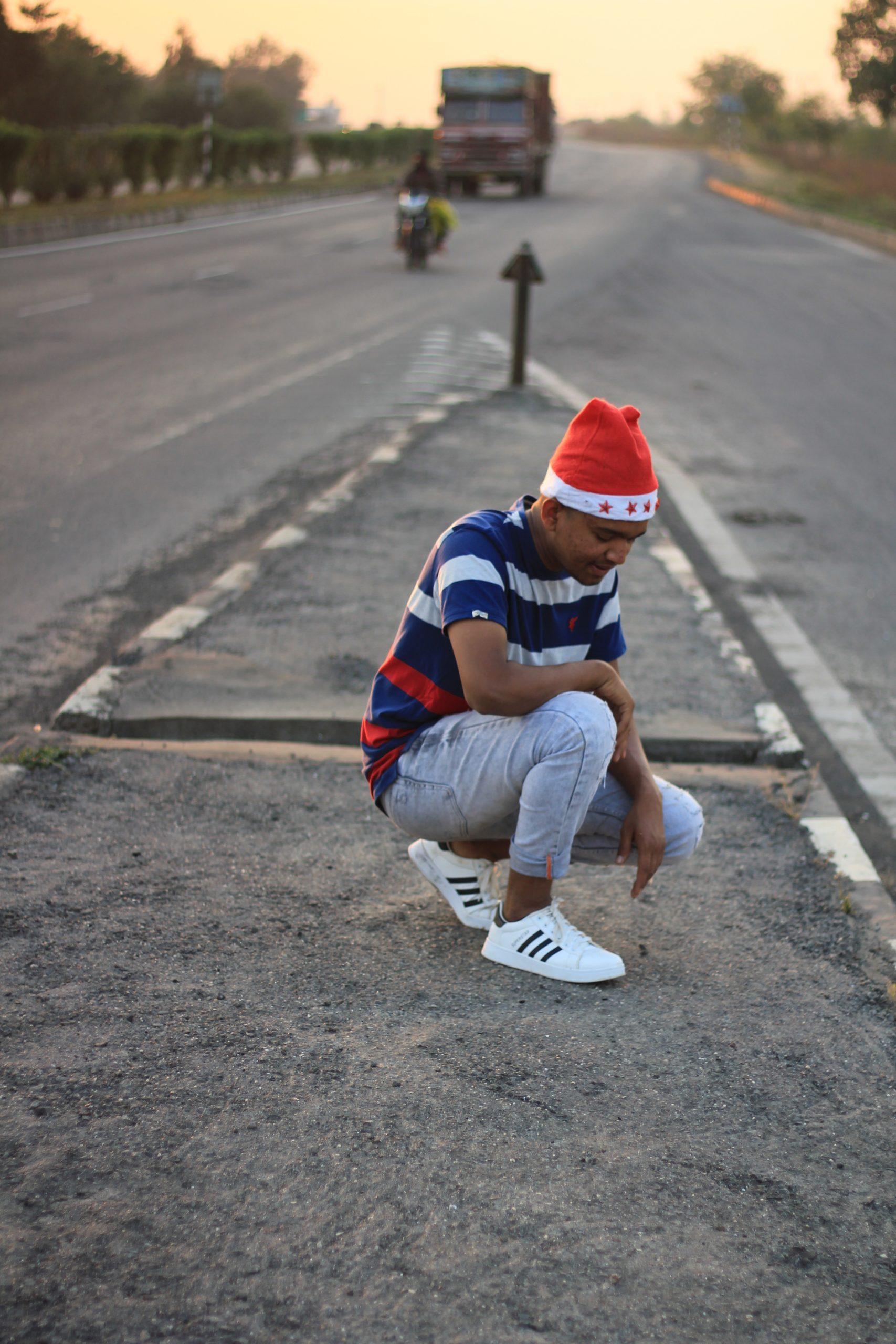 A sad boy on a road