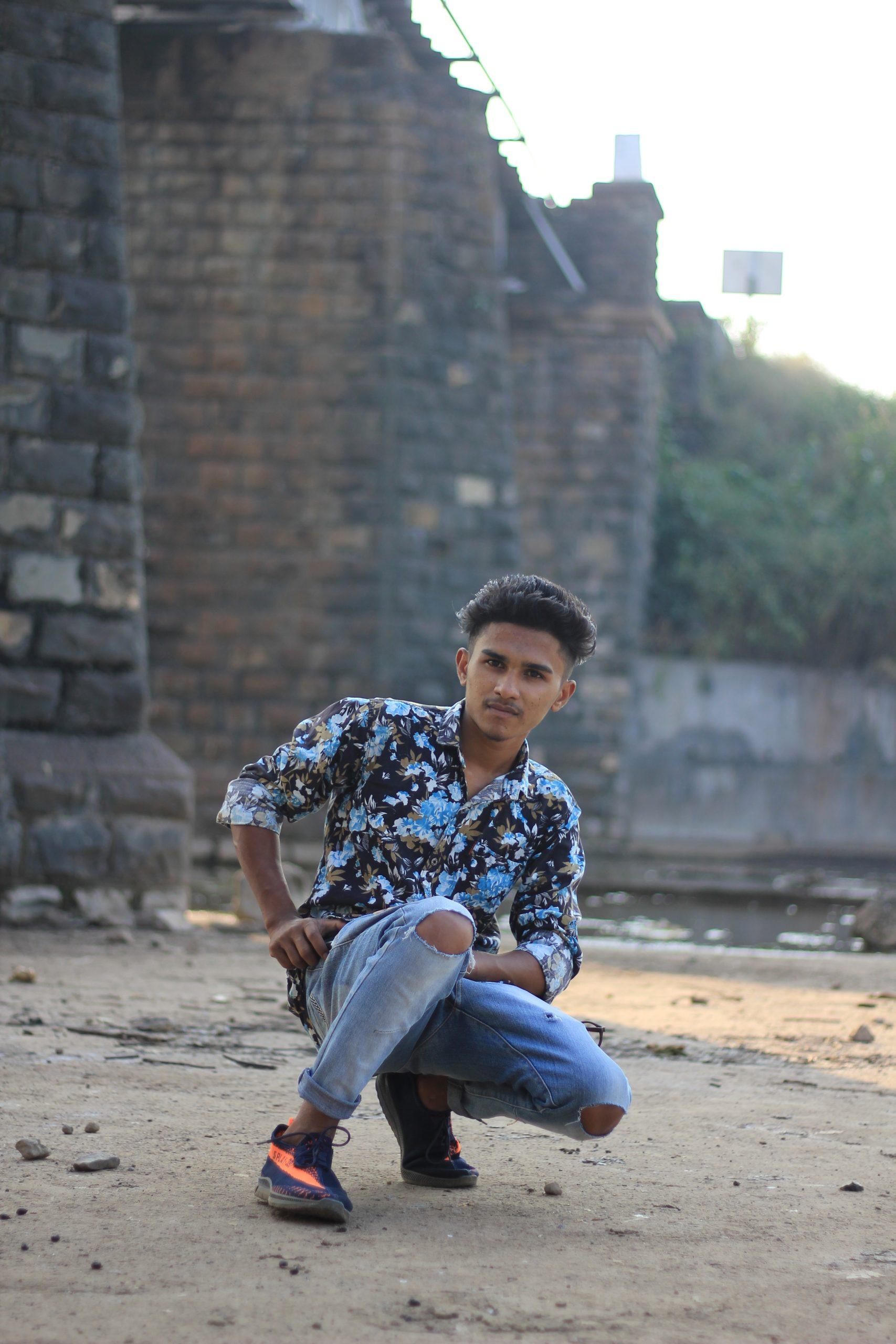 Boy sitting on a ground